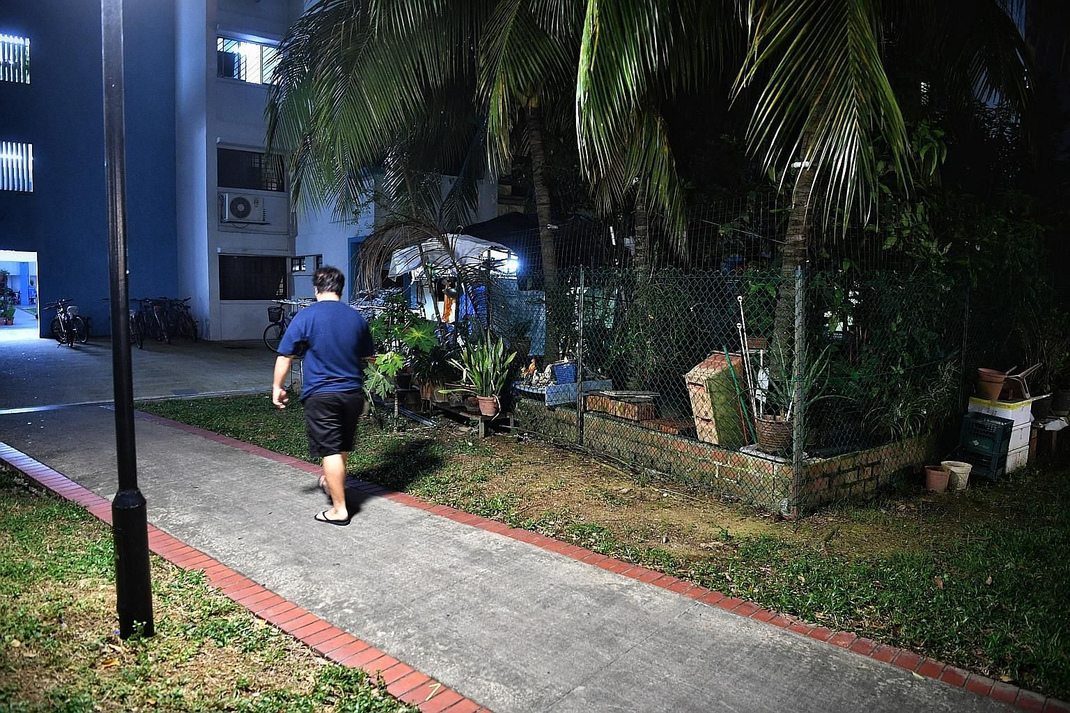 Ms Liang Xueqiu was found injured and lying motionless at Block 211 Boon Lay Place on Thursday, and was pronounced dead in hospital. Her husband, Chinese national Cui Huan, is accused of killing her at a footpath at the block. ST PHOTO: ARIFFIN JAMAR