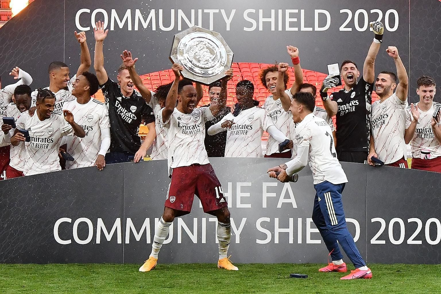 Arsenal captain Pierre-Emerick Aubameyang lifting the Community Shield, after defeating Liverpool on penalties. The Gabon forward has kept Arsenal waiting nervously during protracted talks over his new contract. PHOTO: REUTERS