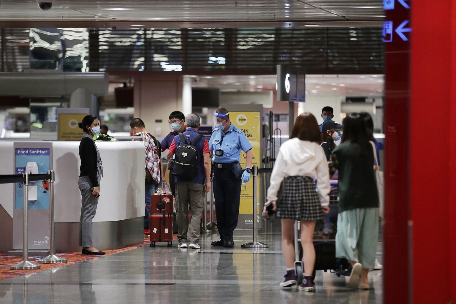 Passengers checking in for Scoot Flight TR100 to Guangzhou early yesterday morning at Changi Airport Terminal 1. Despite a rush for Covid-19 tests after the Chinese Embassy announced new rules on Aug 21, requiring travellers from Singapore to China t
