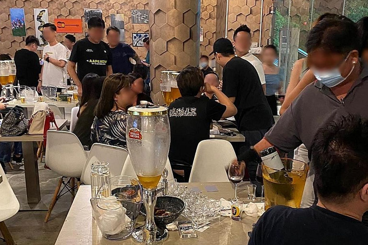 Create Kitchen and Whimsical Bar, which are adjacent to each other, were found to have violated safe management measures. S-Tripes Hotpot, found selling alcoholic beverages after 10.30pm, served the drinks in teapots (left) and green tea bottles to a