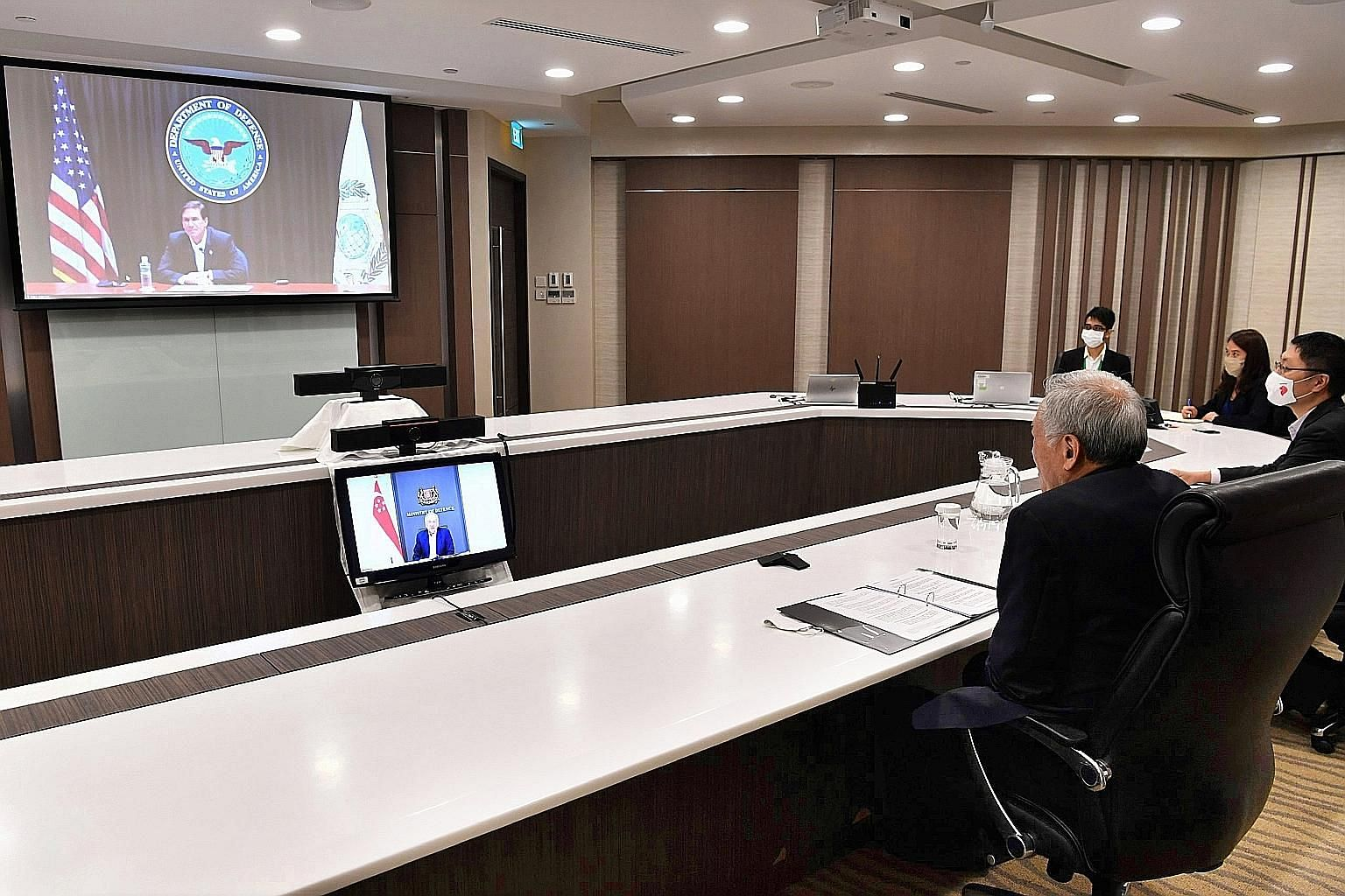 Defence Minister Ng Eng Hen and US Defence Secretary Mark Esper in a videoconference yesterday. Both sides reaffirmed the importance of the US' continued engagement of the region.