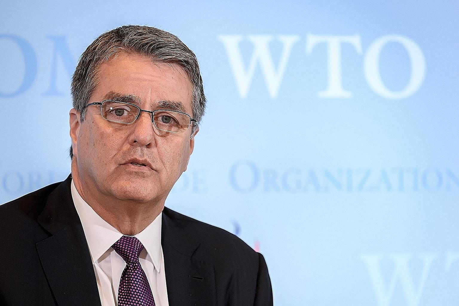 Mr Roberto Azevedo's announcement in May that he would end his second WTO term 12 months early forced the organisation to speed up its process of selecting a new leader. PHOTO: AGENCE FRANCE-PRESSE