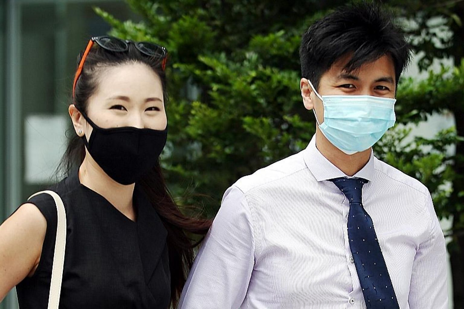 Marathoner Ashley Liew, 33, and wife Sandra Faustina Lee outside the State Court yesterday. He is accusing former teammate Soh Rui Yong of defaming him and is seeking $120,000 in damages. ST PHOTO: WONG KWAI CHOW