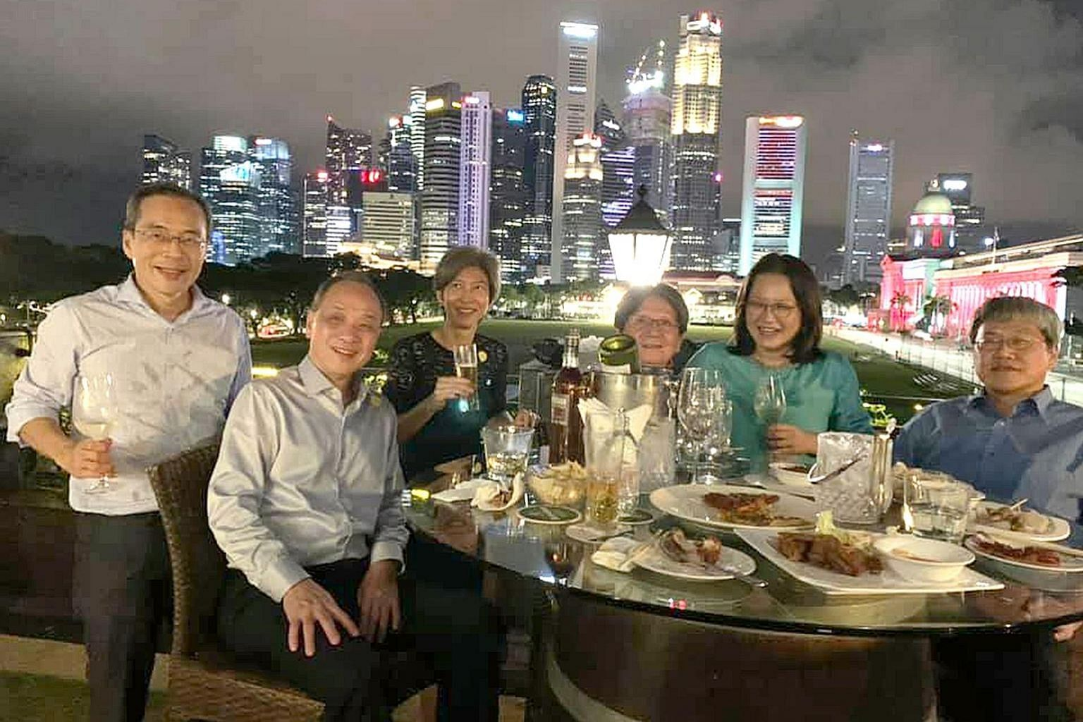 """A picture posted last week by Workers' Party MP Sylvia Lim (second from right) of her having dinner with party colleagues at a rooftop bar near City Hall. She had written: """"Wow, what a skyline."""" With Ms Lim are (from left) Hougang MP Dennis Tan, form"""