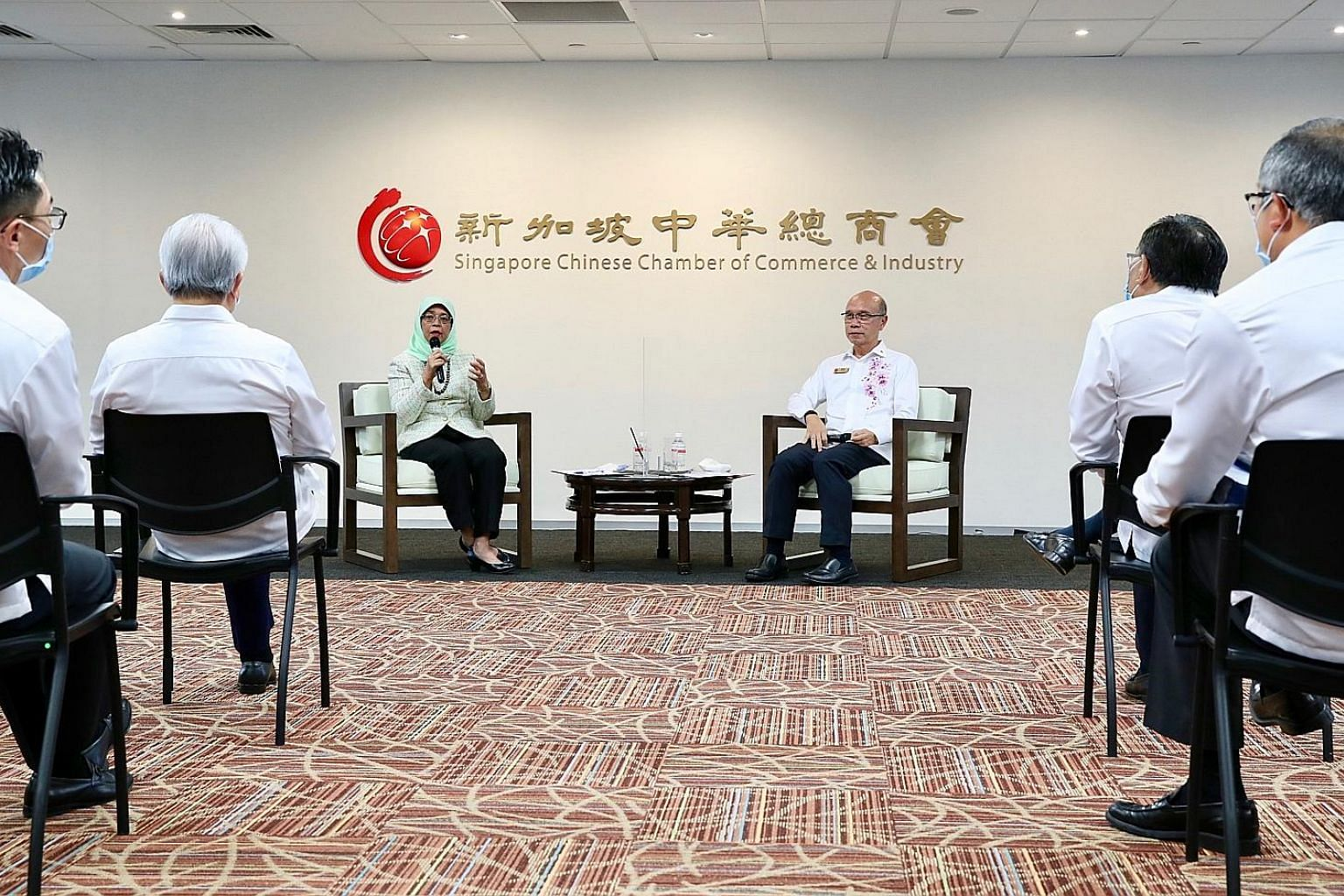 President Halimah Yacob speaking at a dialogue with members of the Singapore Chinese Chamber of Commerce and Industry yesterday. She later said that based on discussions and feedback during the session, companies are exploring new opportunities, such