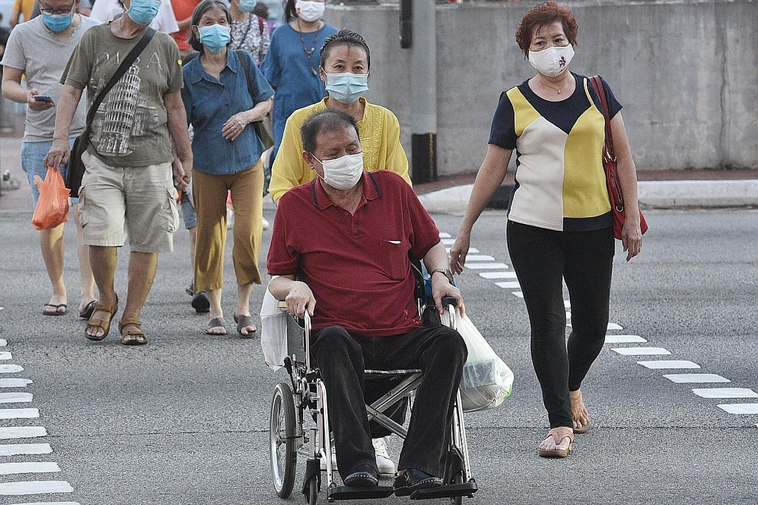 People such as those with physical or mental disabilities, seniors, low-income families and displaced workers should not be left behind as Singapore progresses, said several MPs in Parliament yesterday. ST PHOTO: DESMOND WEE