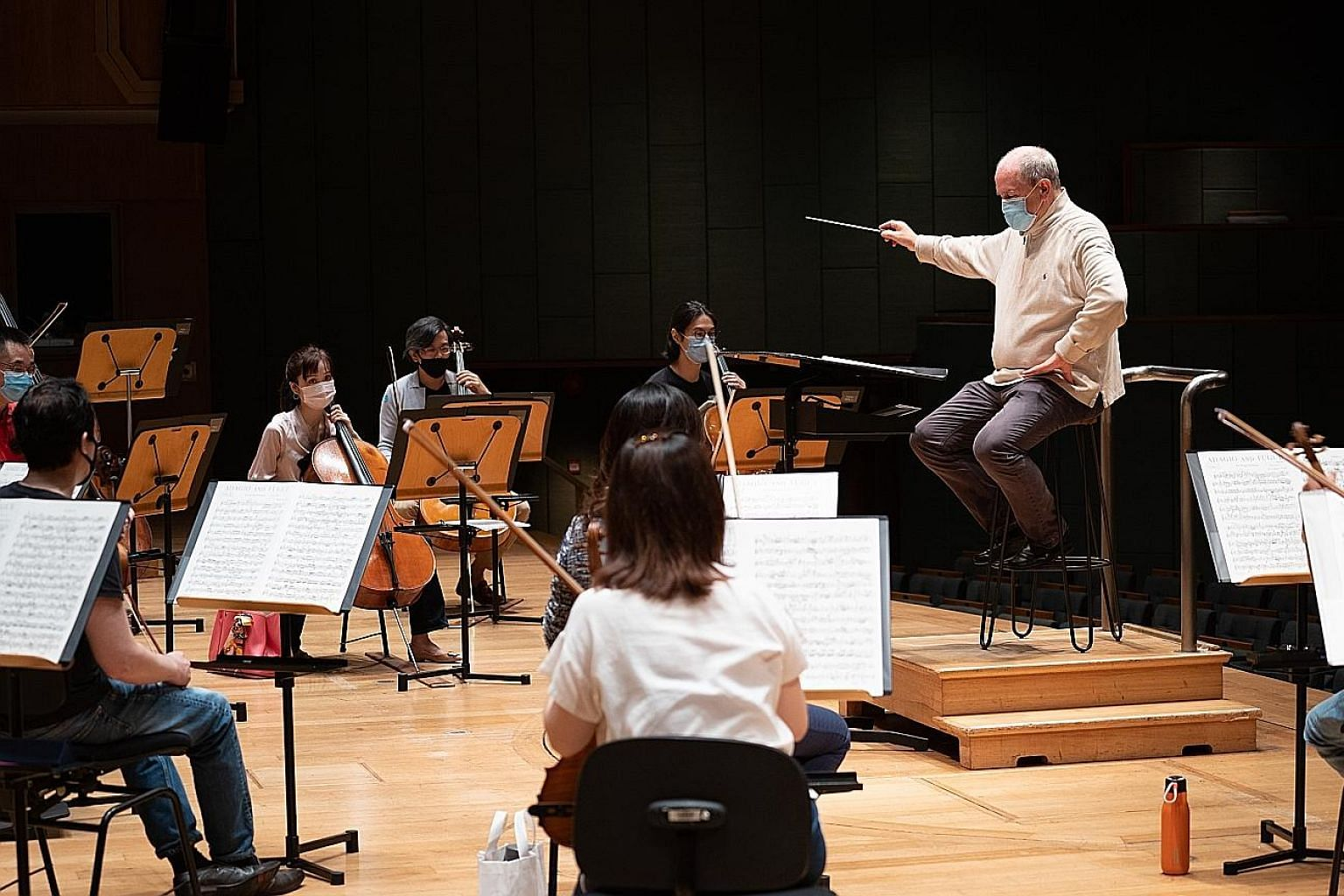 The Singapore Symphony Orchestra's new chief conductor Hans Graf directing the orchestra. Tickets to the SSO's trial concert featuring chamber music by Haydn and Tchaikovsky at Victoria Concert Hall (left) on Oct 8 will be on sale via Sistic.