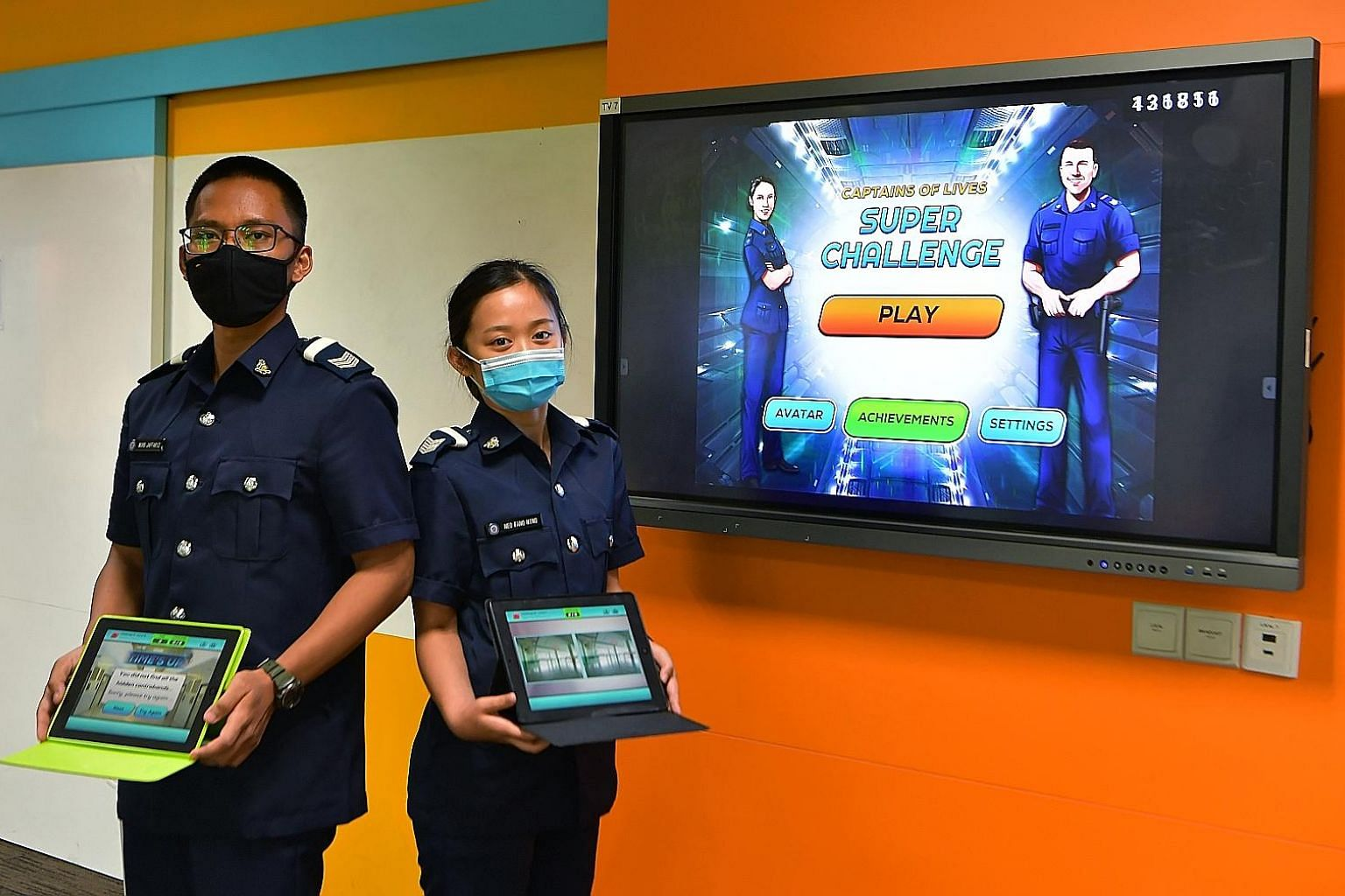 Sergeants Muhammad Jaffariz Siddiq Ahmad Azeri and Neo Fang Ning are among the first group of trainees in the prison officer course to use the gaming-style Mobile Interactive Training Application. The app - which trainees can access on their Singapor