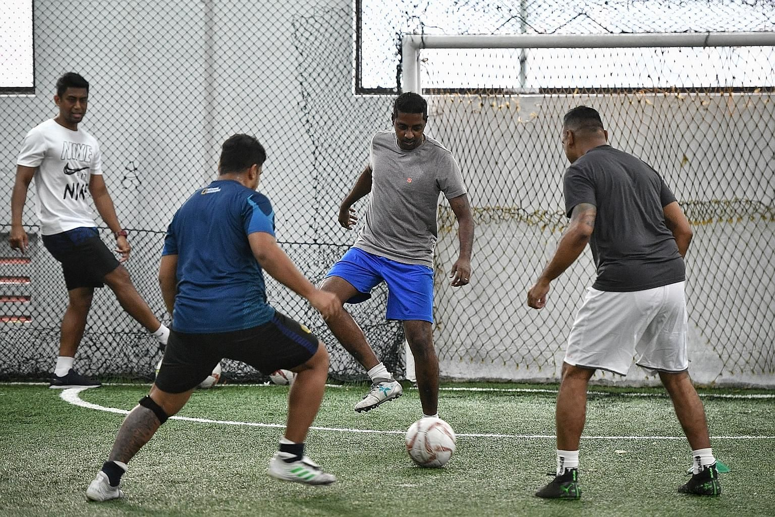 A group at a session of The Cage's recently launched football fitness programme, which allows amateur footballers to try drills done by professionals. ST PHOTO: ARIFFIN JAMAR