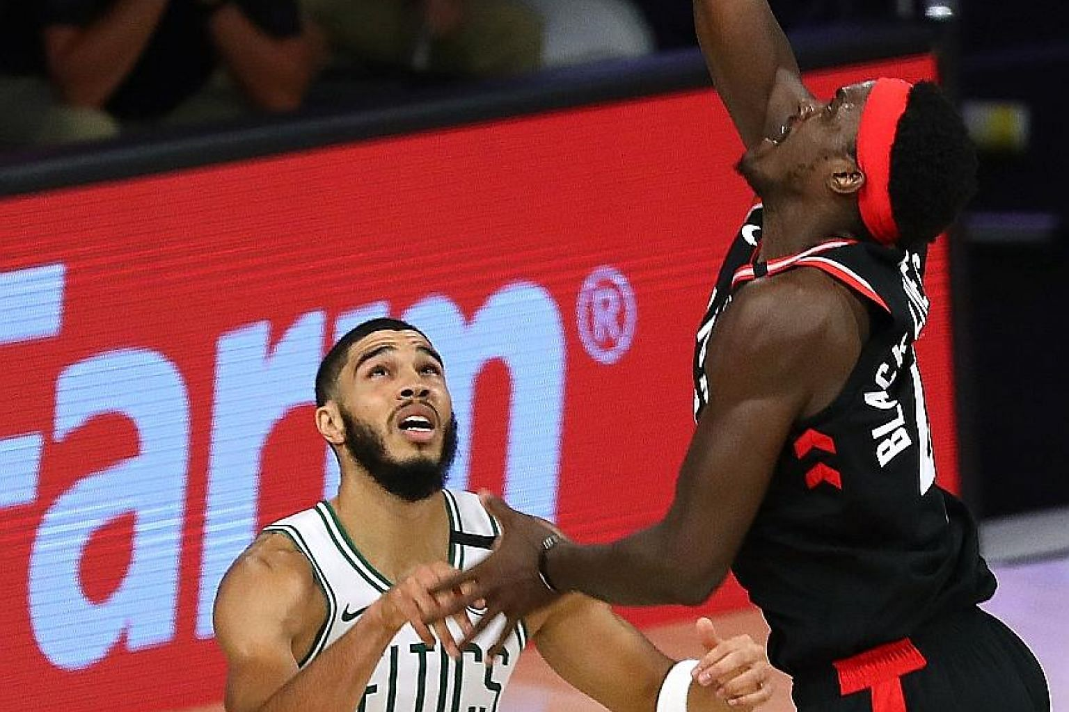 Toronto's Pascal Siakam, finishing with 23 points, making a basket over Boston forward Jayson Tatum during Game 4 of their Eastern Conference semi-final series. The Raptors won 100-93 to level the best-of-seven series. PHOTO: REUTERS