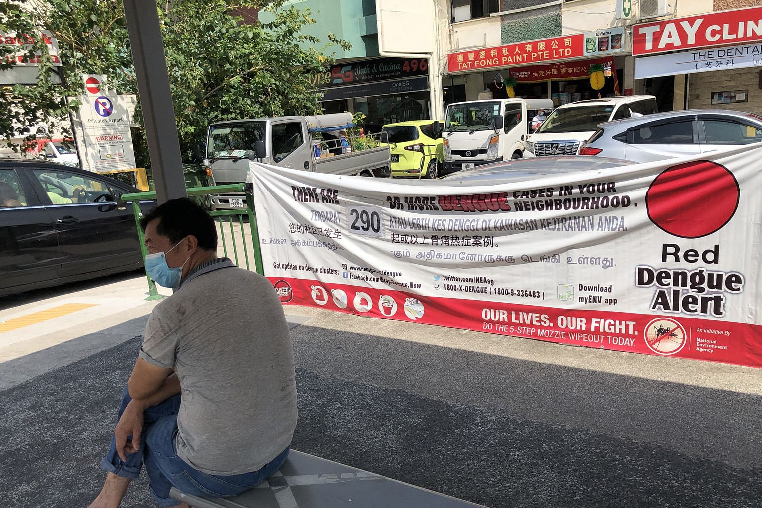 A red alert dengue banner at a bus stop in Geylang Road early last month. It is important for people with dengue to prevent themselves from being bitten again while they remain infectious. Even someone who has been bitten but has no symptoms can stil