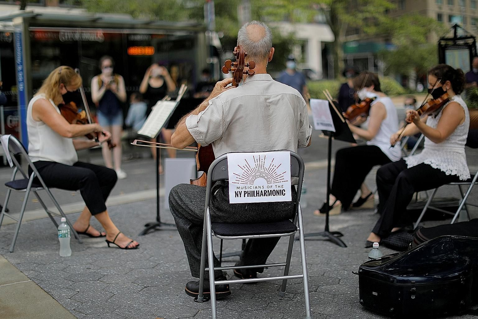 New York Philharmonic Orchestra musicians performing as a string quartet at a park in Manhattan on July 7, the first performance in public since March.