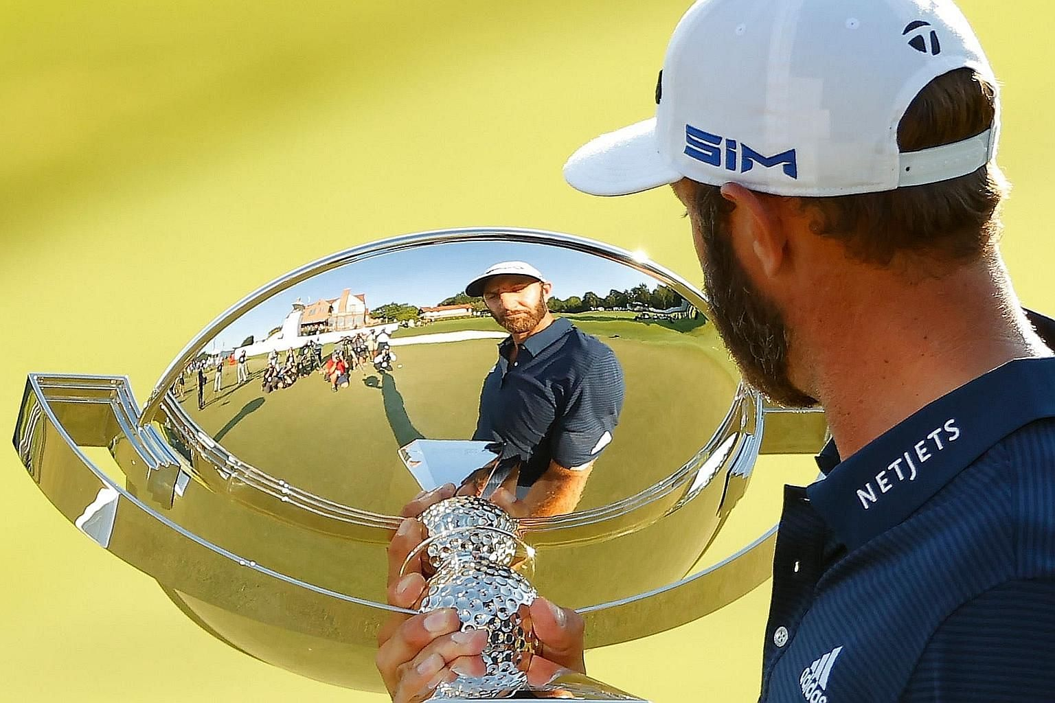 World No. 1 Dustin Johnson admiring the elusive FedExCup trophy after winning the Tour Championship by three shots on Monday. PHOTO: AGENCE FRANCE-PRESSE