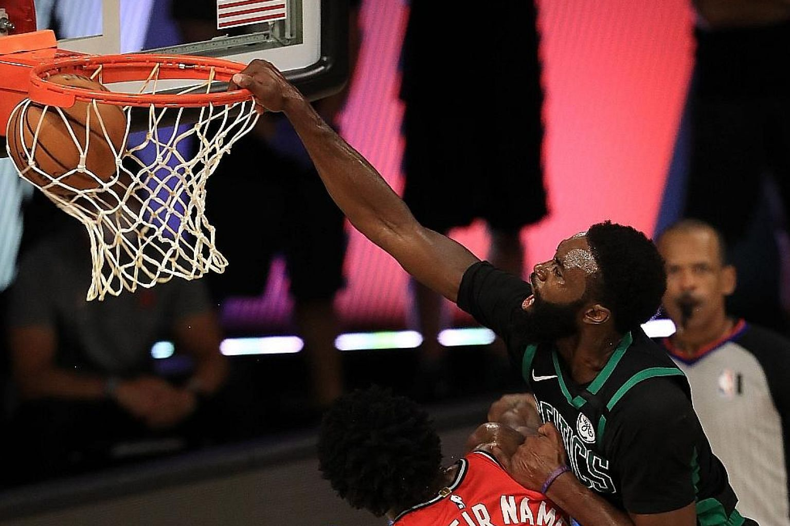 Celtics star Jaylen Brown dunking over Raptors forward O. G. Anunoby during Game 5 of their NBA Eastern Conference semi-final series. Brown had a game-high 27 points. PHOTO: AGENCE FRANCE-PRESSE