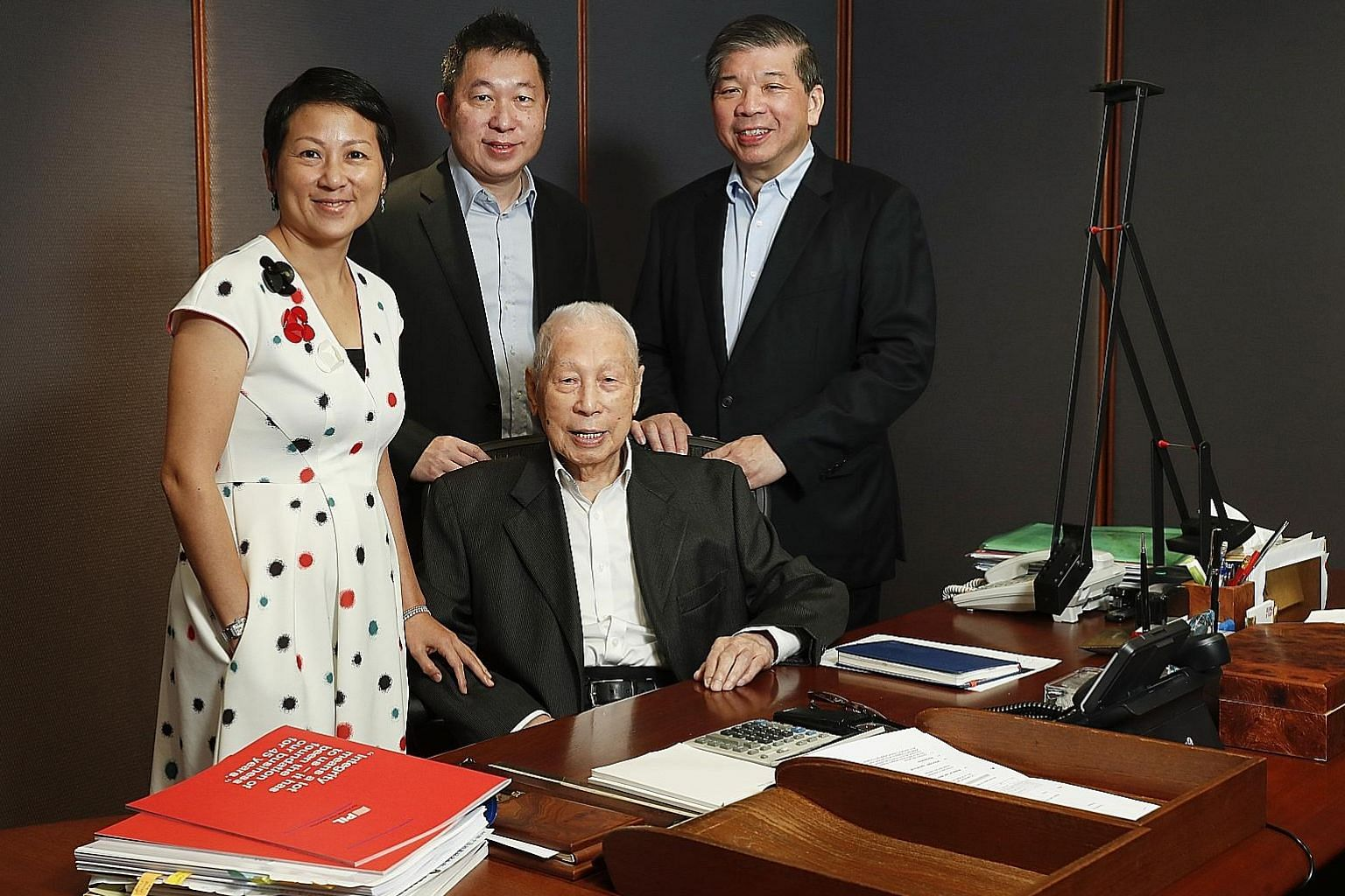 Mr Teo Woon Tiong pictured in 2018 with the second-generation business leaders of Pacific International Lines: (from left) executive director of corporate development Lisa Teo, executive director of the fleet division Teo Choo Wee and executive chair