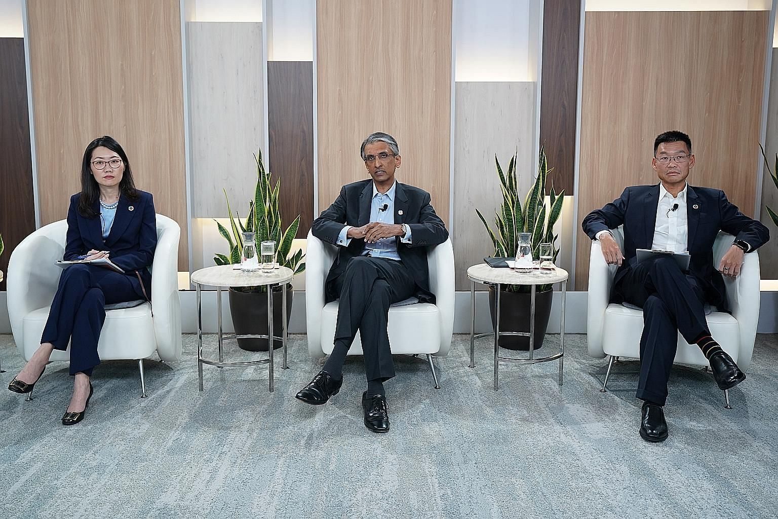 (From far left) Deputy chief financial officer and head of financial services Png Chin Yee, Temasek International chief executive Dilhan Pillay and senior managing director of the enterprise development group and deputy head of Singapore projects Yeo