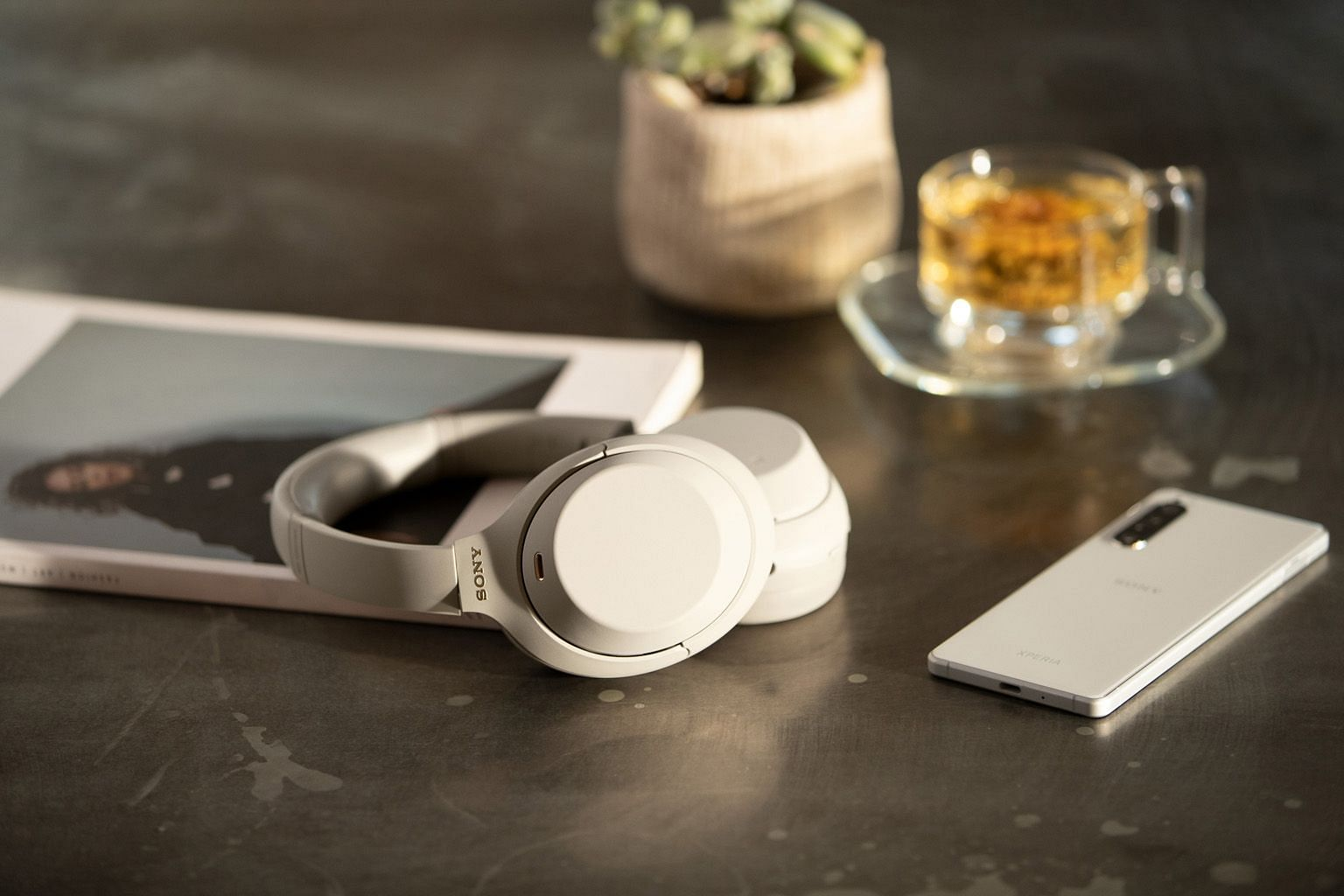 The Sony WH-1000XM4 can connect to two devices at the same time, and pauses music playback and lets in ambient sound when it detects you are talking.