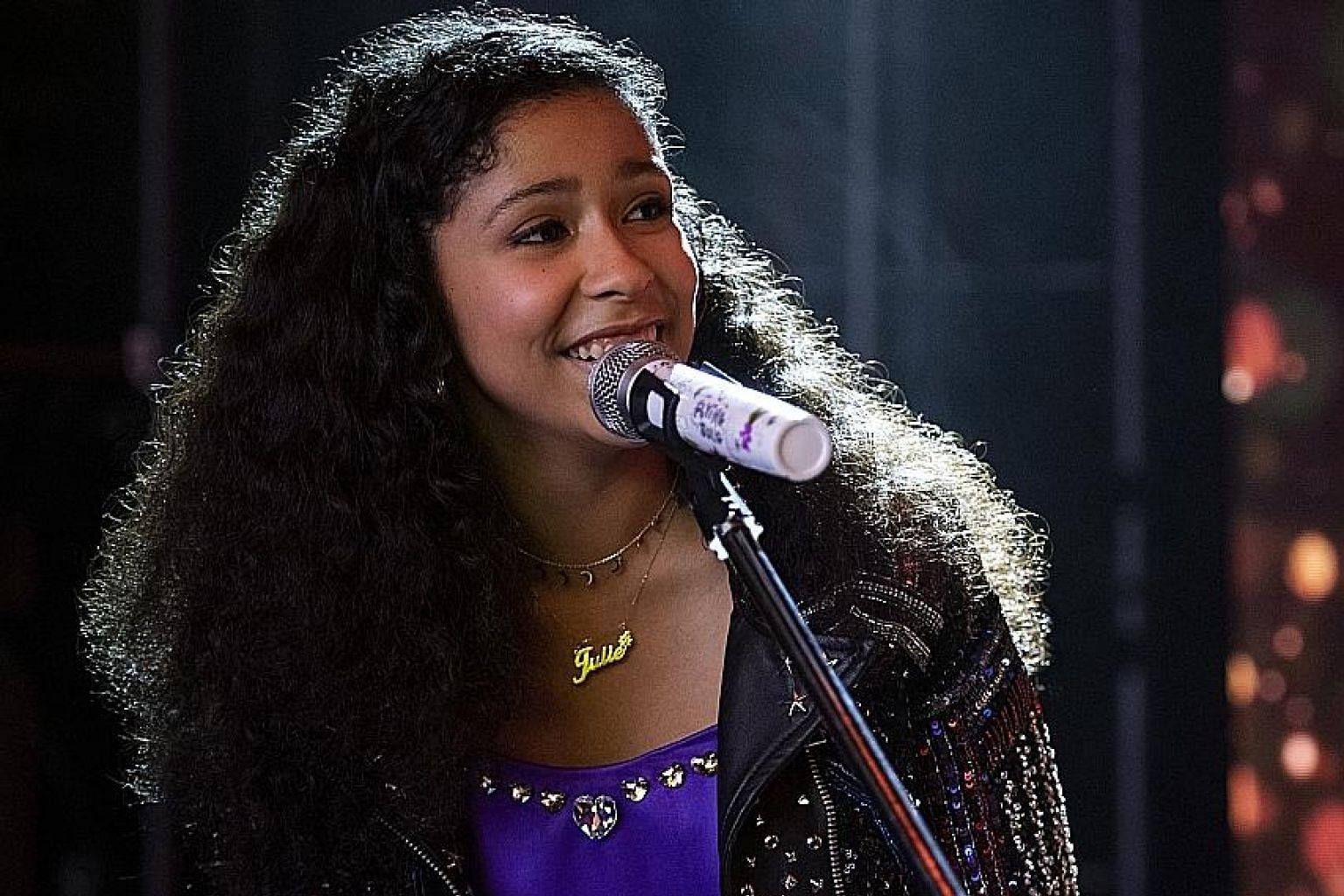 Madison Reyes as the title character in teen musical series Julie And The Phantoms.