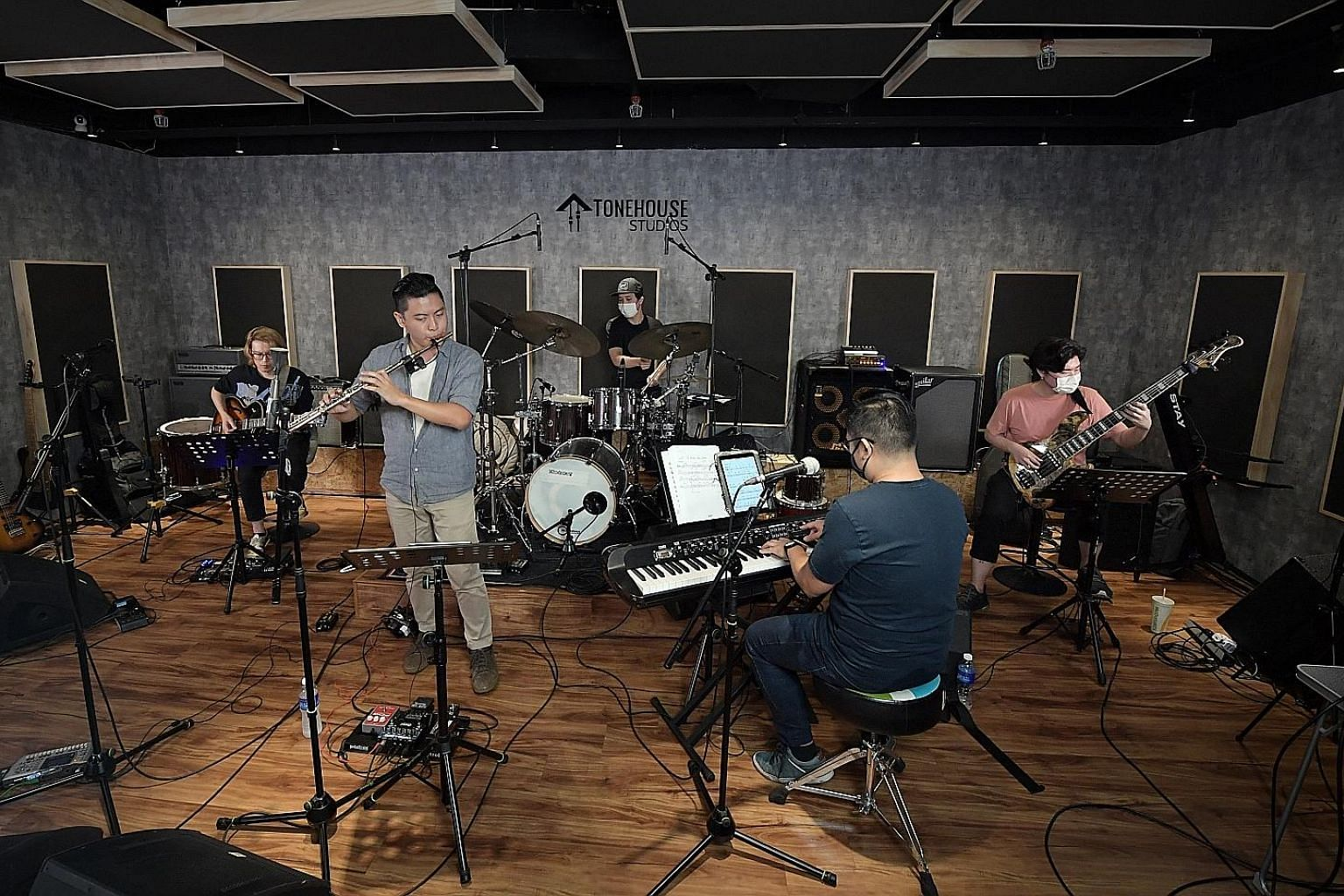 Local jazz musicians (above, from far left) Sebastian Ho, Rit Xu, Teo Jia Rong, Jordan Wei and Ben Poh doing a live-stream performance at music studio Tonehouse on Monday.