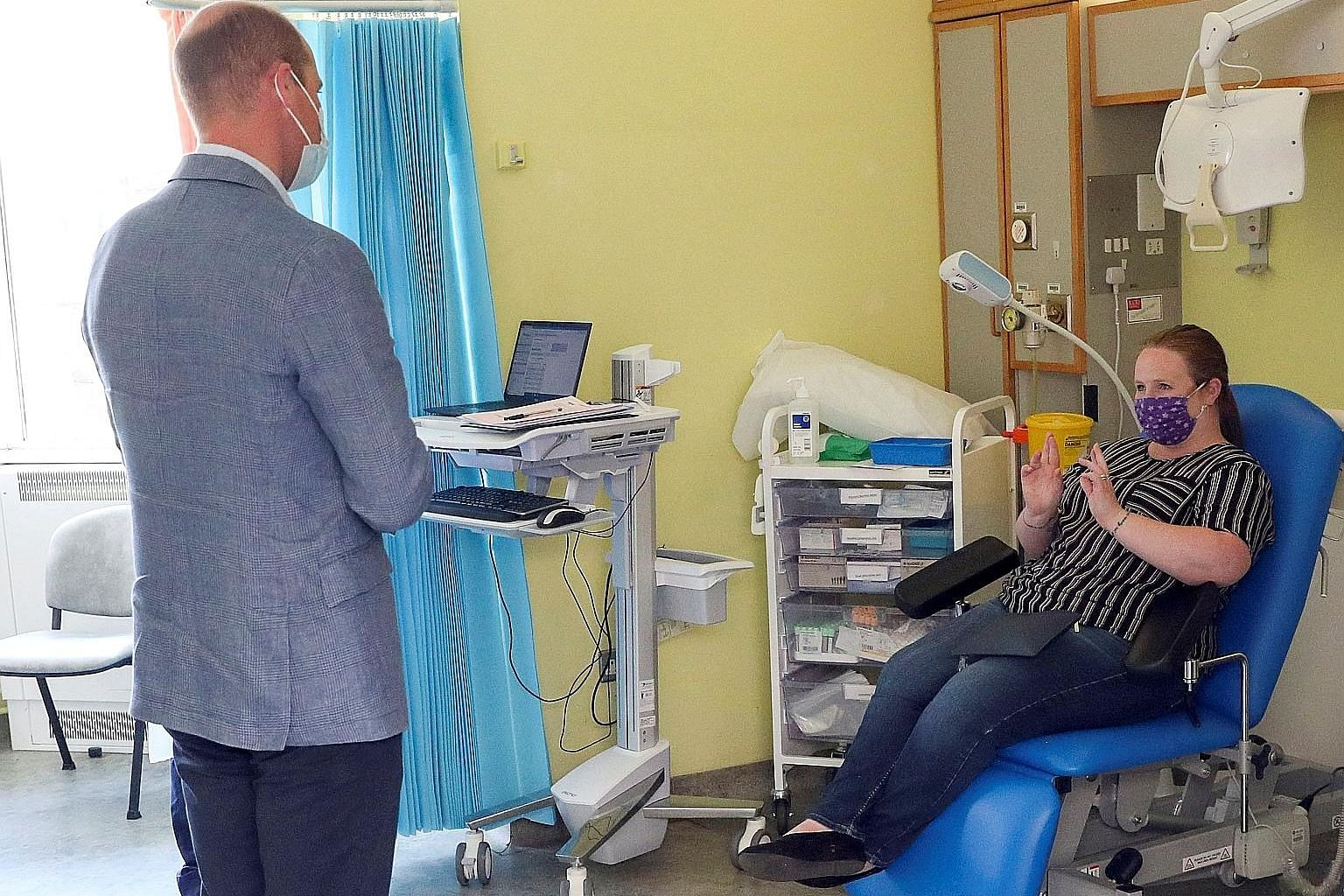 Britain's Prince William talking to a patient participating in a Covid-19 vaccine trial during a visit to the Oxford Vaccine Group's facility at Churchill Hospital in Oxford in June. British drugmaker AstraZeneca's vaccine, which the company is devel