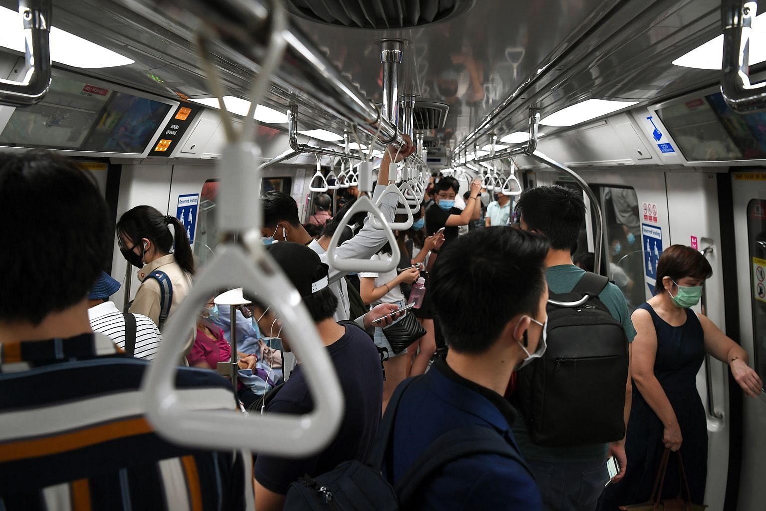 """Education Minister Lawrence Wong stressed the need to have """"a good part of workers"""" travelling after 9.30am to reduce the risk of large crowds gathering in public transport, in public spaces and in office buildings."""
