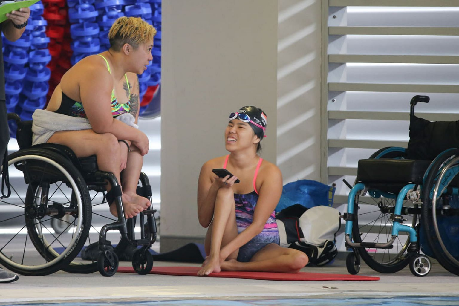Theresa Goh and Yip Pin Xiu at last year's SPH Foundation National Inclusive Swimming Championships. Goh wants to serve on the SDSC's exco now that she has more energy and time while Yip wants to get more athletes with disabilities to play sport. ST