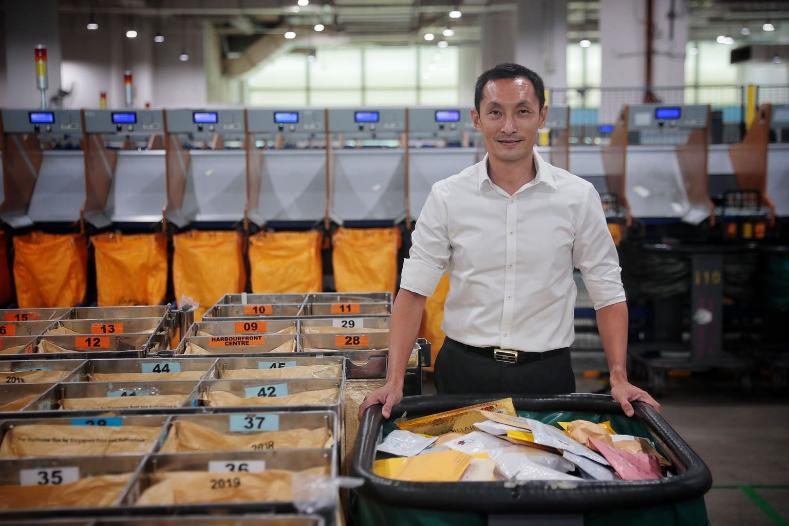 Postmaster-general Vincent Phang wants to work with online sellers amid a boom in e-commerce triggered by the pandemic. PHOTO: JASON QUAH