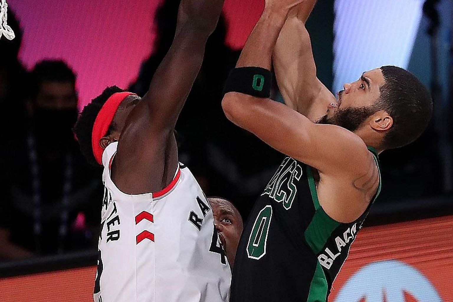Boston's Jayson Tatum going for a shot as Toronto's Pascal Siakam defends in Game Seven of their Eastern Conference semi-finals in Lake Buena Vista, Florida. Boston eliminated the champions and are aiming to reach the NBA Finals for the first time in