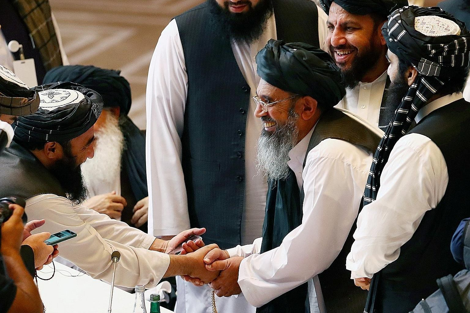 Taleban delegates at a ceremony yesterday in Doha, Qatar, to launch talks with an Afghan government team, aimed at ending two decades of war.