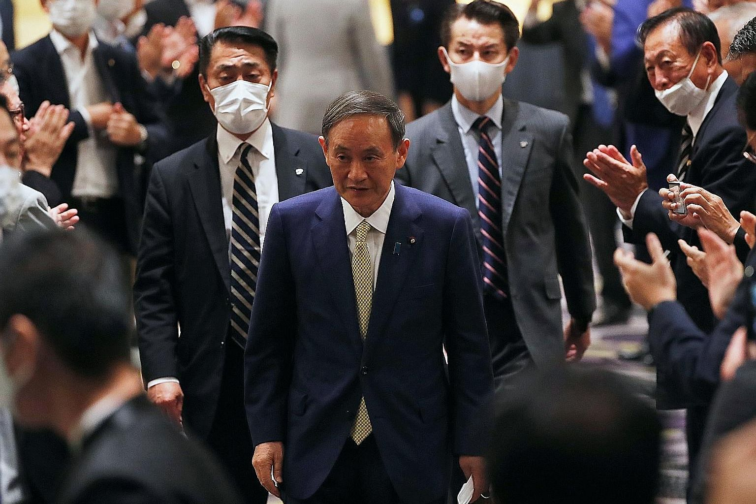 Japan's Chief Cabinet Secretary Yoshihide Suga in Tokyo last Tuesday after officially kicking off his campaign rally for the ruling Liberal Democratic Party's (LDP) presidential election. He wields tremendous political and bureaucratic influence, tak
