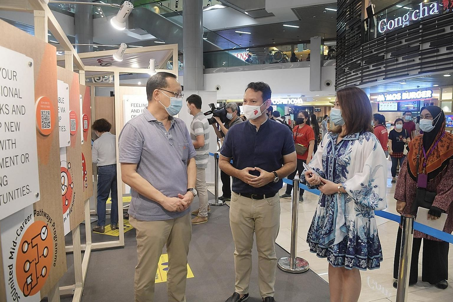 Senior Minister of State for Manpower and Defence Zaqy Mohamad (centre) at the SGUnited Jobs and Skills information kiosk at Causeway Point yesterday, with Workforce Singapore chief executive Tan Choon Shian and principal manager of the corporate mar