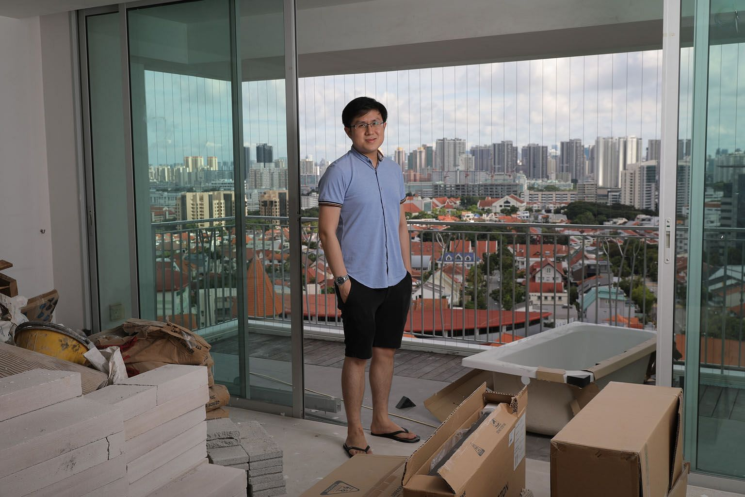 """Mr Wong Jing Yean's 120 sq m DBSS unit at Natura Loft in Bishan Street 24 has a balcony and offers a panoramic view of the city skyline. The million-dollar price tag was an """"attractive price point"""" for the 32-year-old, as the unit has double the spac"""