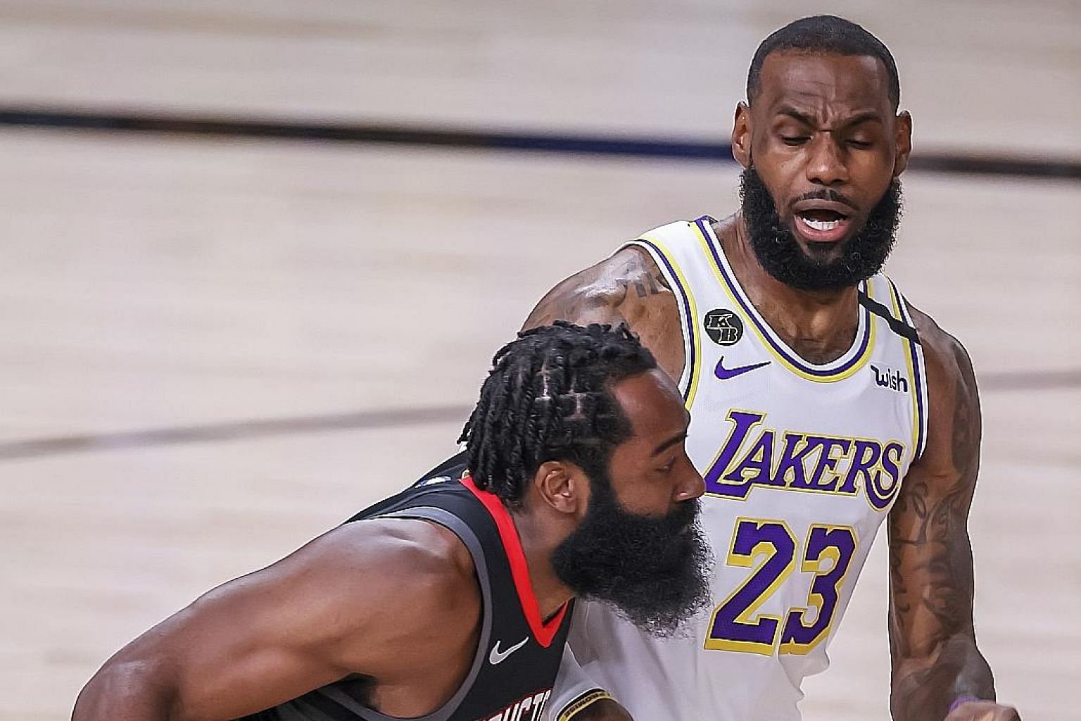 Rockets guard James Harden taking on Lakers forward LeBron James in Game 5 of their Western Conference semi-finals. The Lakers cruised to a 119-96 victory to win the series 4-1. PHOTO: EPA-EFE