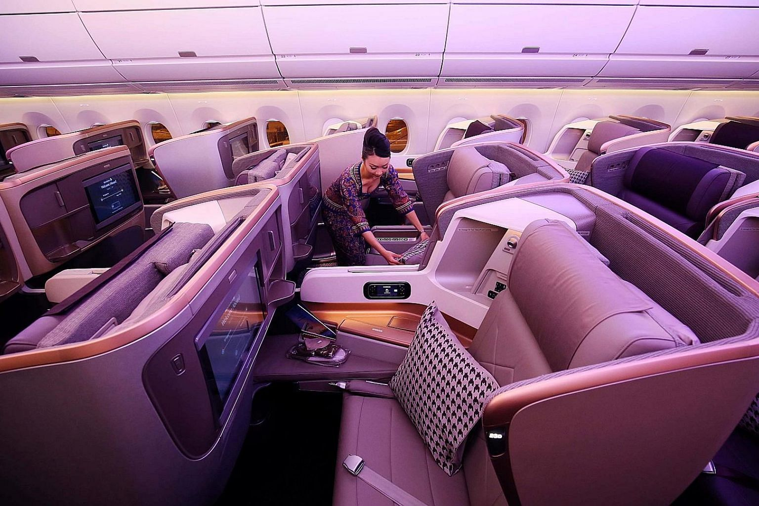 Singapore Airlines' business class seats. Airlines somehow need to keep filling premium seats, or get rid of them. According to one expert, a single business class seat needs to generate at least four times the profit of an economy seat to justify al