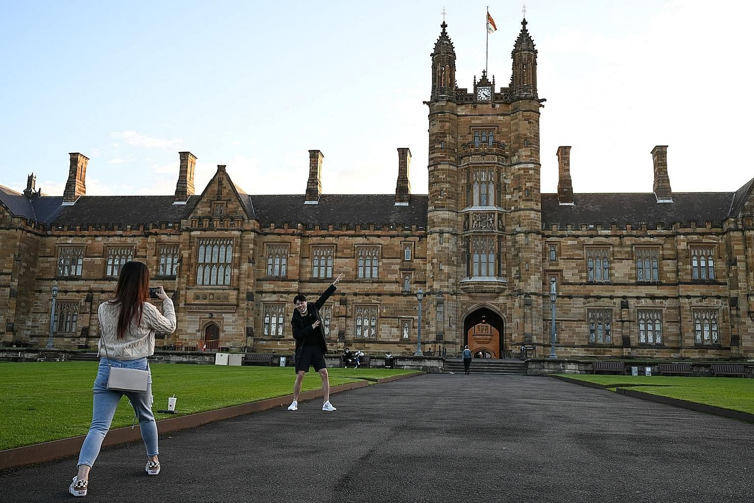 International students from China taking photos on campus at the University of Sydney in Australia. Some 19,000 Singapore students are enrolled in universities in the United States, Britain and Australia. Last month, Education Minister Lawrence Wong