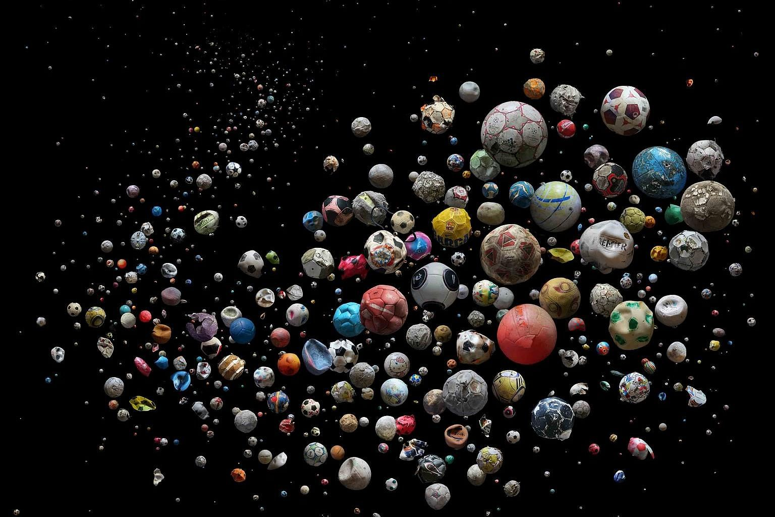 British photographer Mandy Barker's work features 633 soccer balls collected from 23 countries and islands in Europe, found on 104 beaches by 62 members of the public in just four months. A display showing the plastic rubbish collected on Singapore's