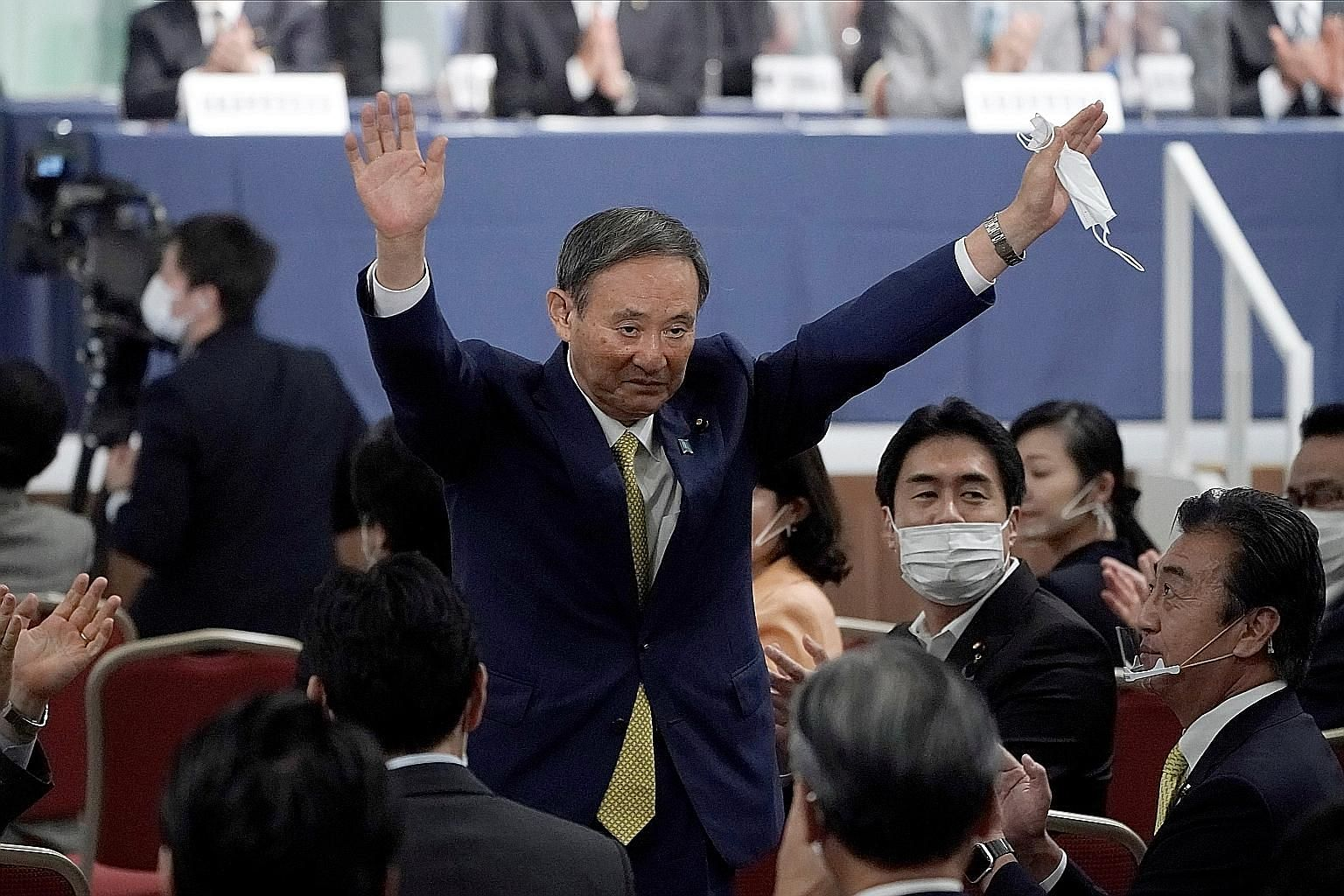 Japanese Chief Cabinet Secretary Yoshihide Suga acknowledging his victory after he was elected the new head of the ruling Liberal Democratic Party at the party's leadership election in Tokyo yesterday. He was the runaway champion, winning around 70 p