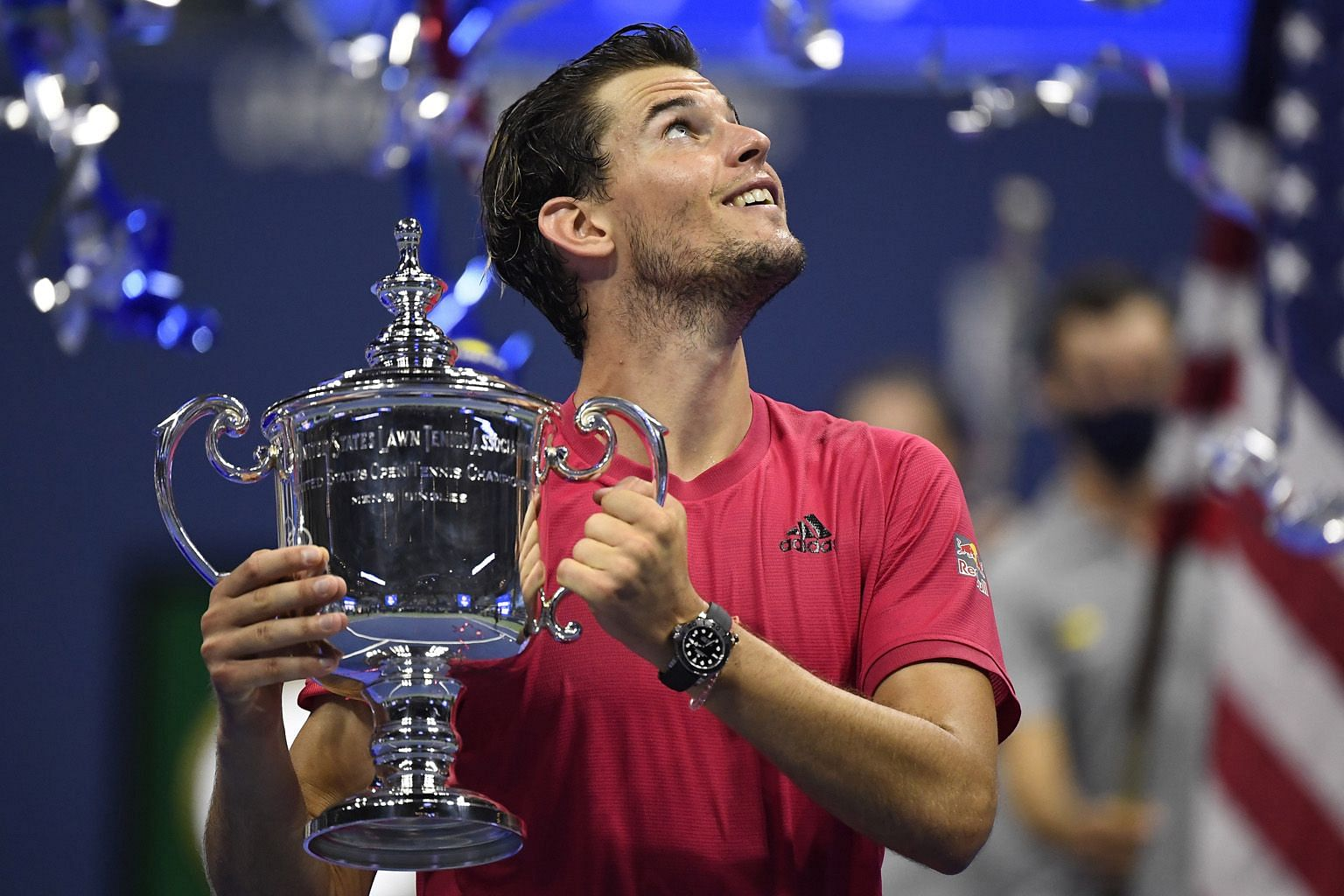 Dominic Thiem of Austria celebrates with the US Open winner's trophy after beating Germany's Alexander Zverev in the men's singles final. He is the first player outside of Rafael Nadal, Novak Djokovic and Roger Federer to win a Grand Slam in four yea