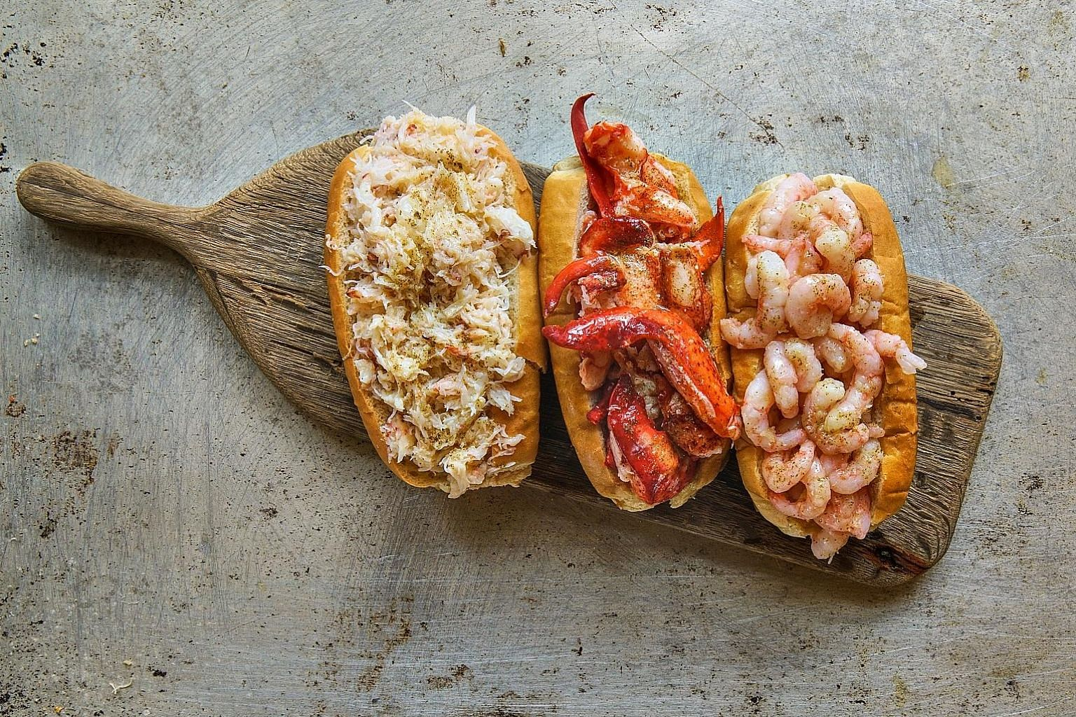 All three classic Luke's Lobster rolls - (from left) Crab Roll, Lobster Roll and Prawn Roll - will be available at Luke's Lobster Singapore.