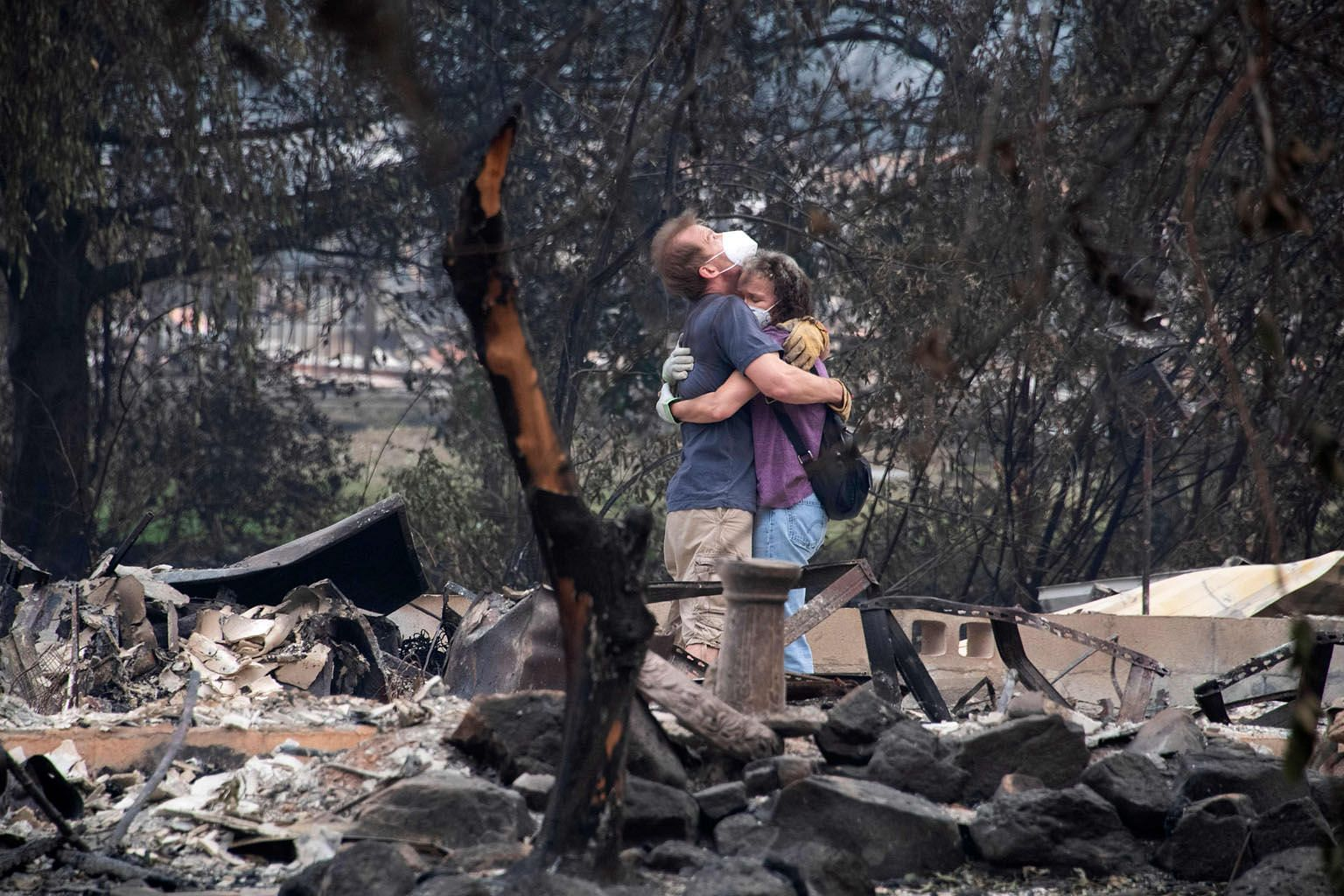 Ms Dee Perez comforting Mr Michael Reynolds at the ruins of his home that was destroyed in the Almeda Fire in Talent, Oregon on Tuesday.