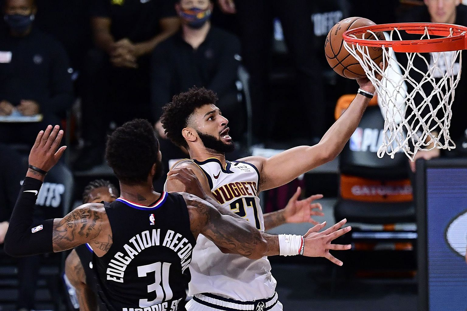 Denver Nuggets guard Jamal Murray scoring two of his game-high 40 points to set up a Western Conference finals match-up with the Los Angeles Lakers. PHOTO: AGENCE FRANCE-PRESSE