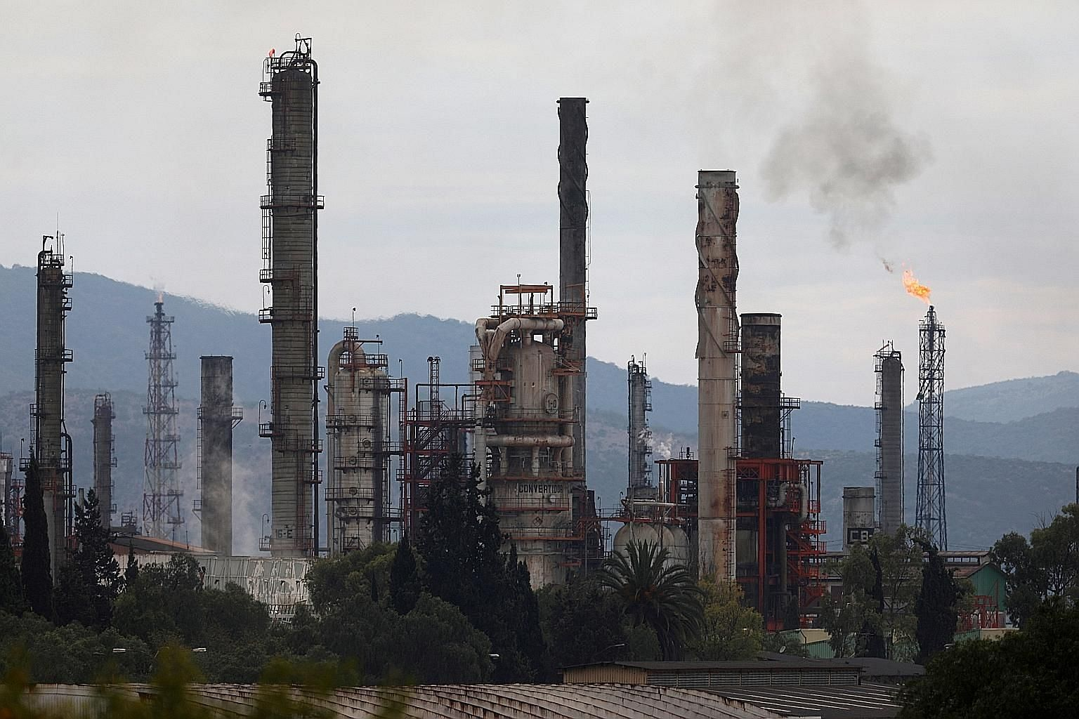 Excess natural gas being burned, or flared, from state-owned Pemex's Tula oil refinery in Tula de Allende, Mexico, on June 22. Rather than making greater effort to mitigate the demand for energy through conservation and energy-efficiency drives, or p