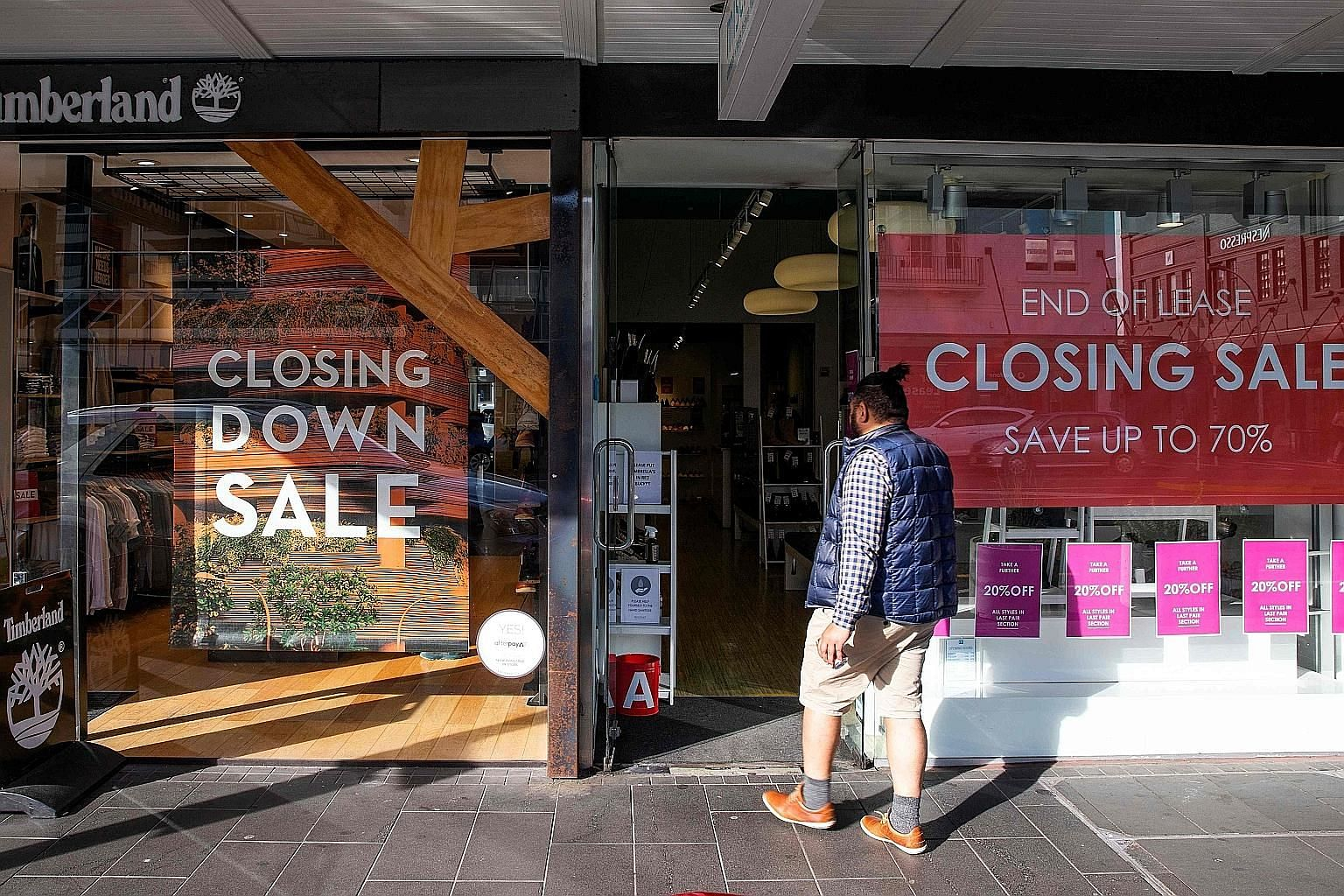 A shop in Auckland - New Zealand's largest city - having its closing-down sale in June, as a strict, seven-week nationwide lockdown to combat the coronavirus that ended in May brought the country to a standstill and led the South Pacific nation to su