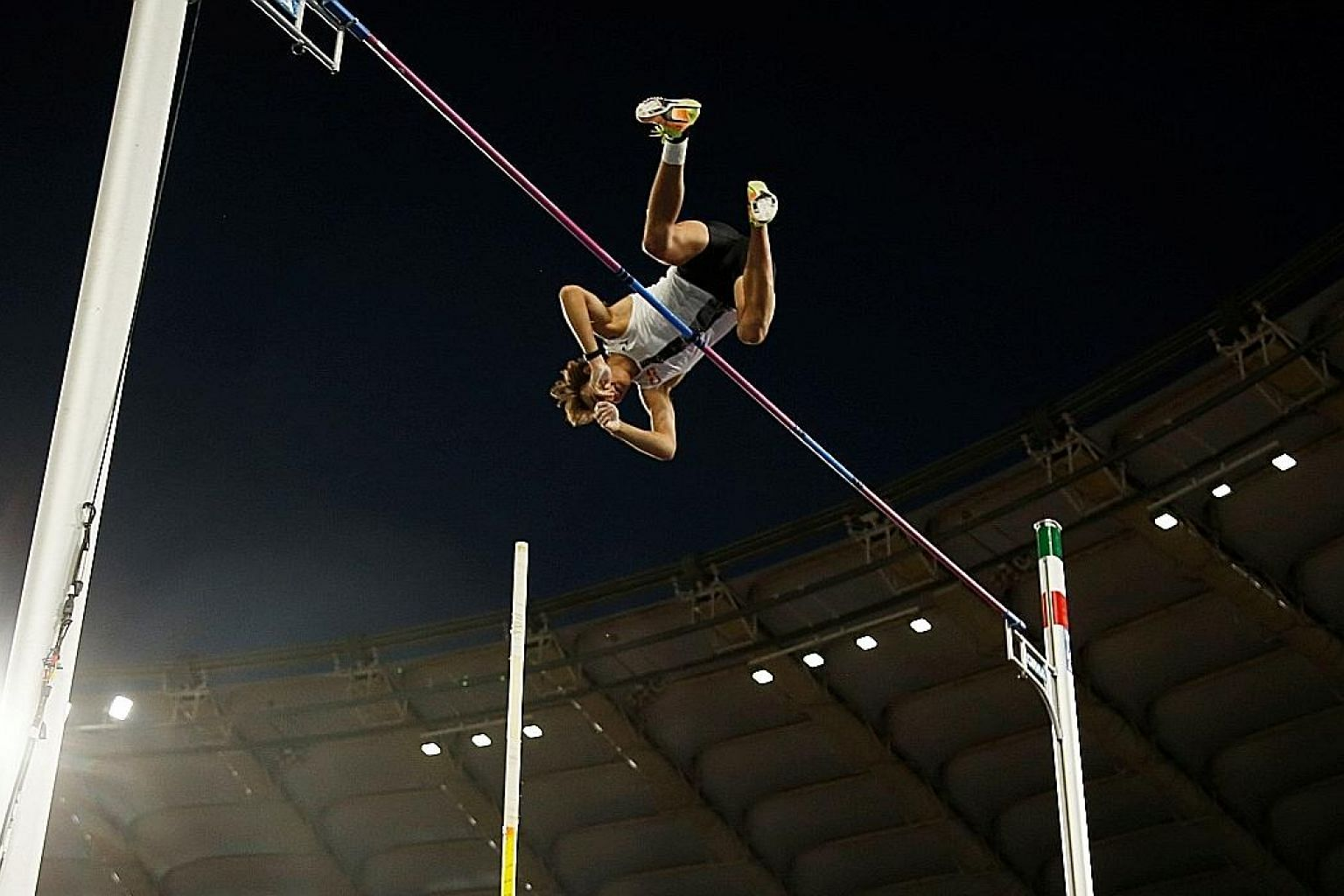 """Left: Sweden's Armand Duplantis clearing 6.15m on his second attempt at the Diamond League meet in Rome on Thursday. Above: Duplantis, 20, said it felt """"surreal and super crazy"""" to break Sergey Bubka's 26-year-old outdoor pole vault world record."""