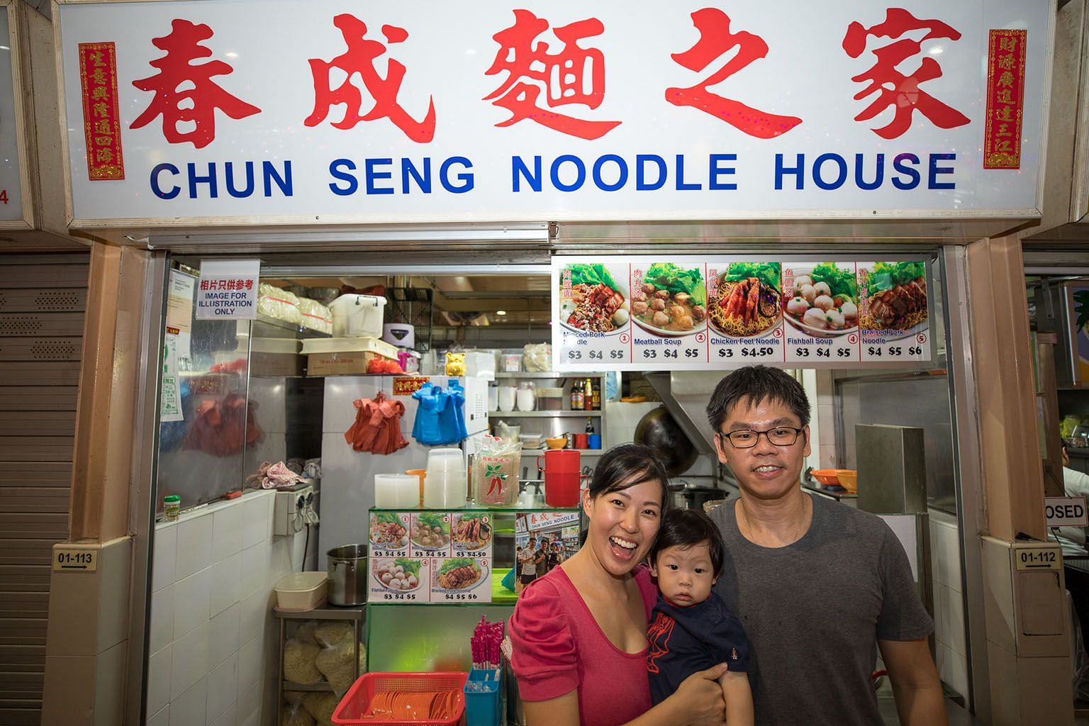 Ms Fiona Lim and Mr Jerry Ng at their bak chor mee stall with their one-year-old son. They have been given an average of 40 per cent rental rebates over 15 months since October last year. PHOTO: NEA