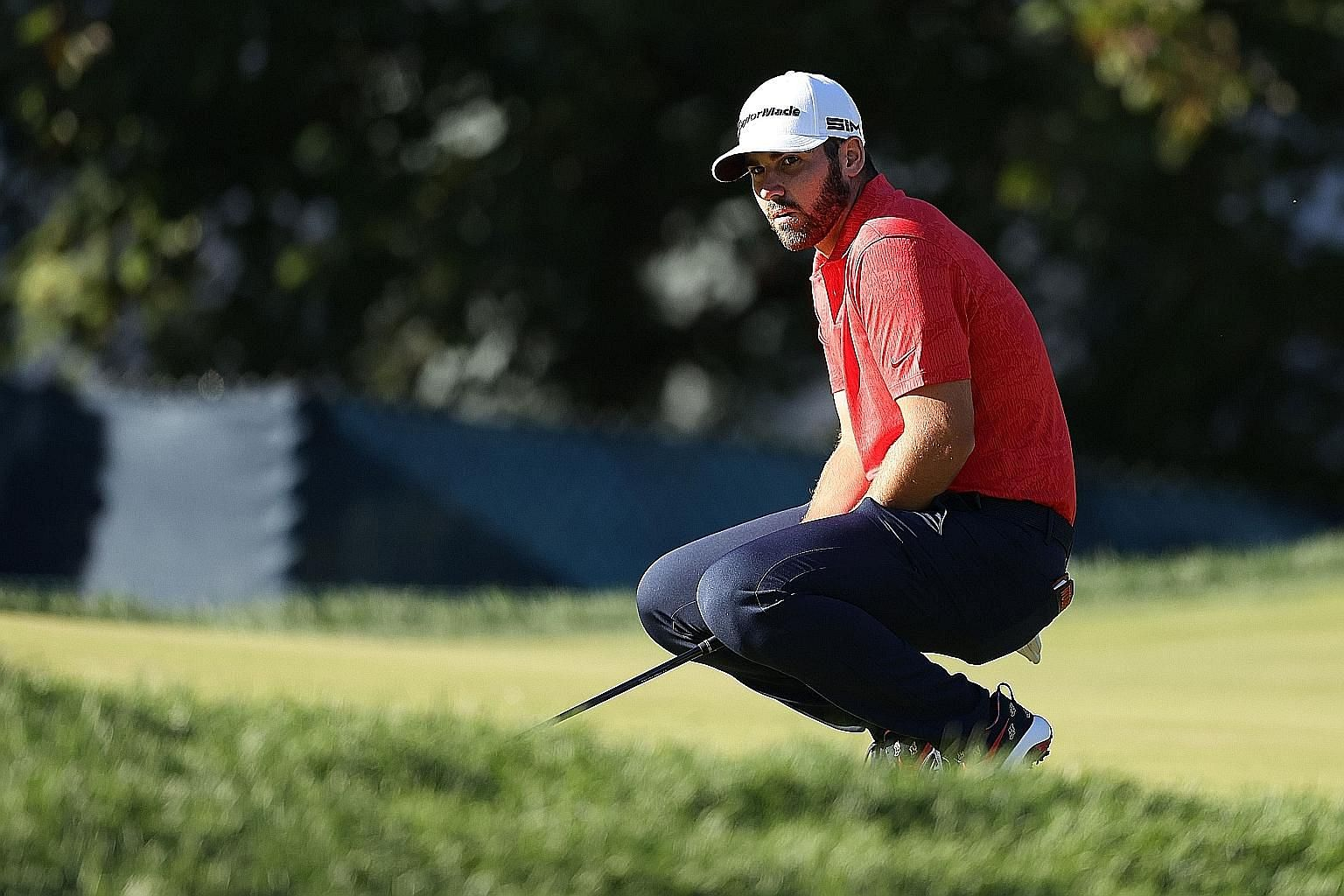 Matthew Wolff reacting to a missed birdie putt on the 15th hole in the third round on Saturday at Winged Foot Golf Club. He was aiming to be the youngest US Open champion in the modern era. PHOTO: AGENCE FRANCE-PRESSE