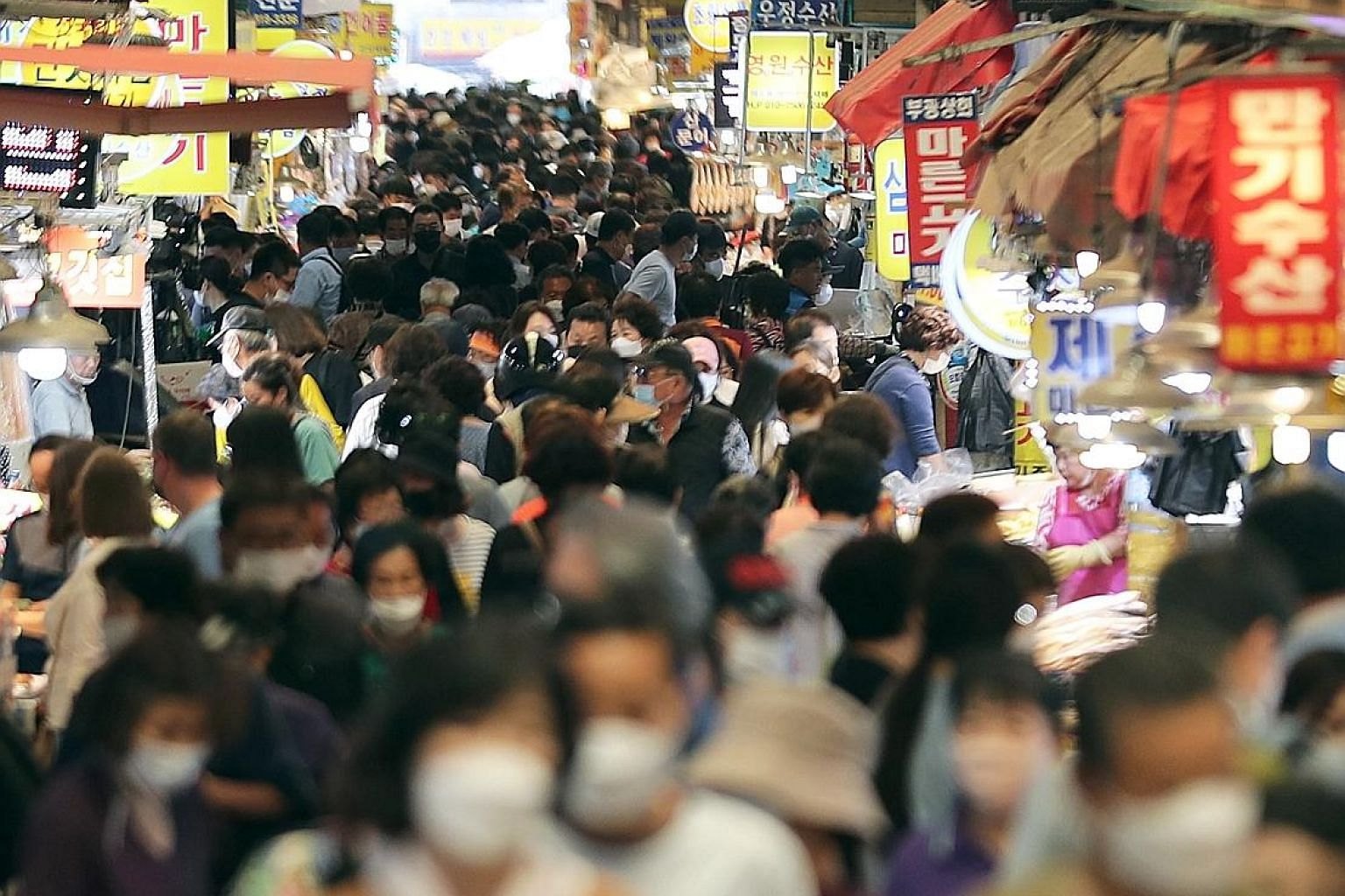 A crowded marketplace in Busan, South Korea, yesterday, ahead of the Chuseok holiday which takes place from Sept 30 to Oct 2. Social distancing policies for the holiday will be announced in the coming days as the authorities remain concerned about Co