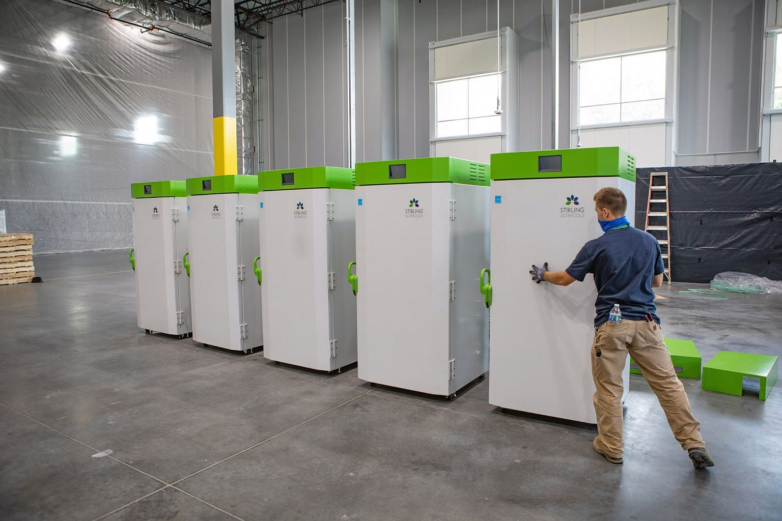 A UPS employee arranging freezers at the company's hub in Louisville, Kentucky, where it is constructing a so-called freezer farm that will be able to store millions of vaccine doses at sub-zero temperatures. PHOTO: NYTIMES Vials made by Corning usin