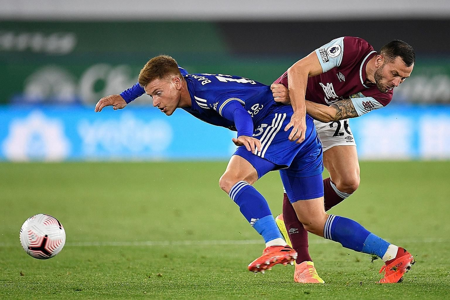 Leicester City midfielder Harvey Barnes gets into a tussle with Burnley's Phil Bardsley as the Foxes claim a 4-2 win at home.