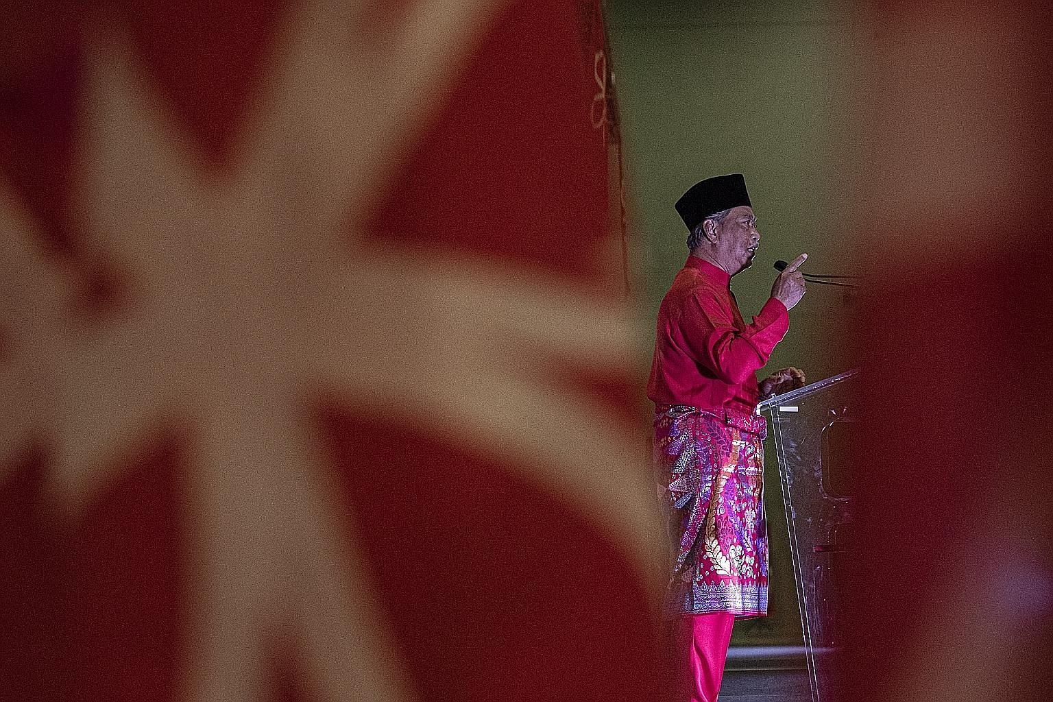 Malaysian Prime Minister Muhyiddin Yassin delivering a speech at Parti Pribumi Bersatu Malaysia's fourth anniversary celebrations in Kuala Lumpur earlier this month. He faces the very real possibility that his crop of MPs would be halved in the event
